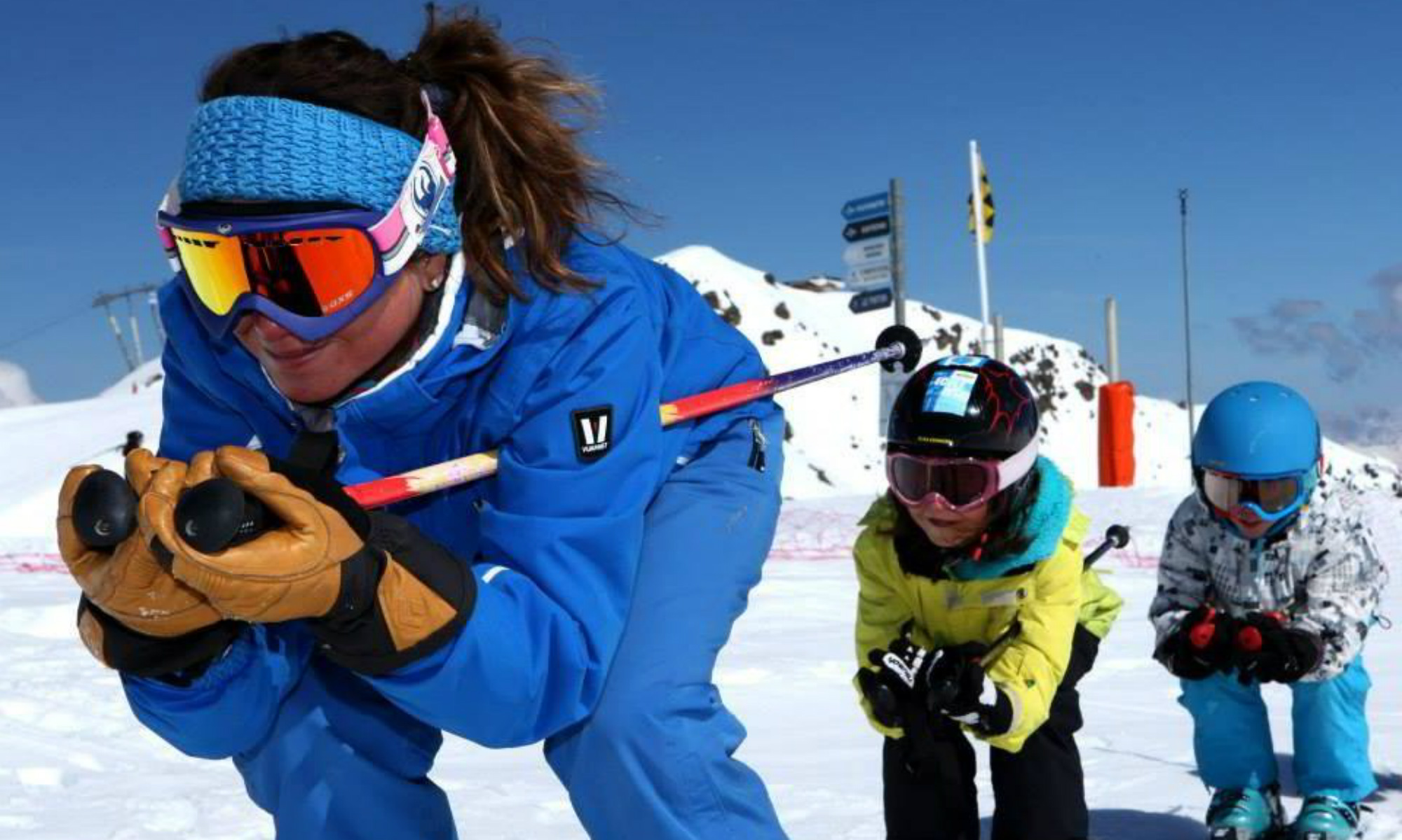 Young skiers and their instructor on the slopes at Méribel.