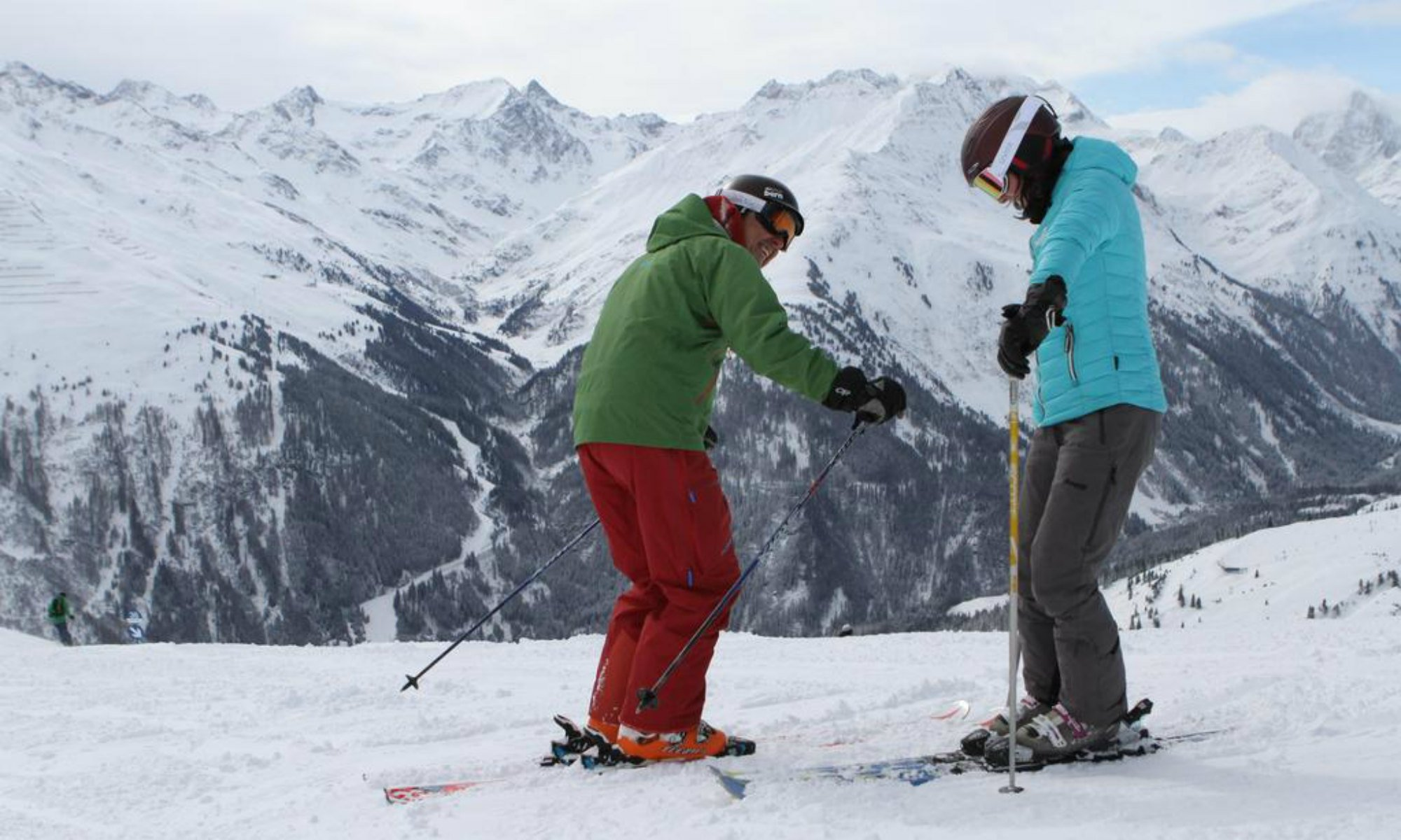 A private ski instructor and a skier on a slope in the Austrian resort Lech.