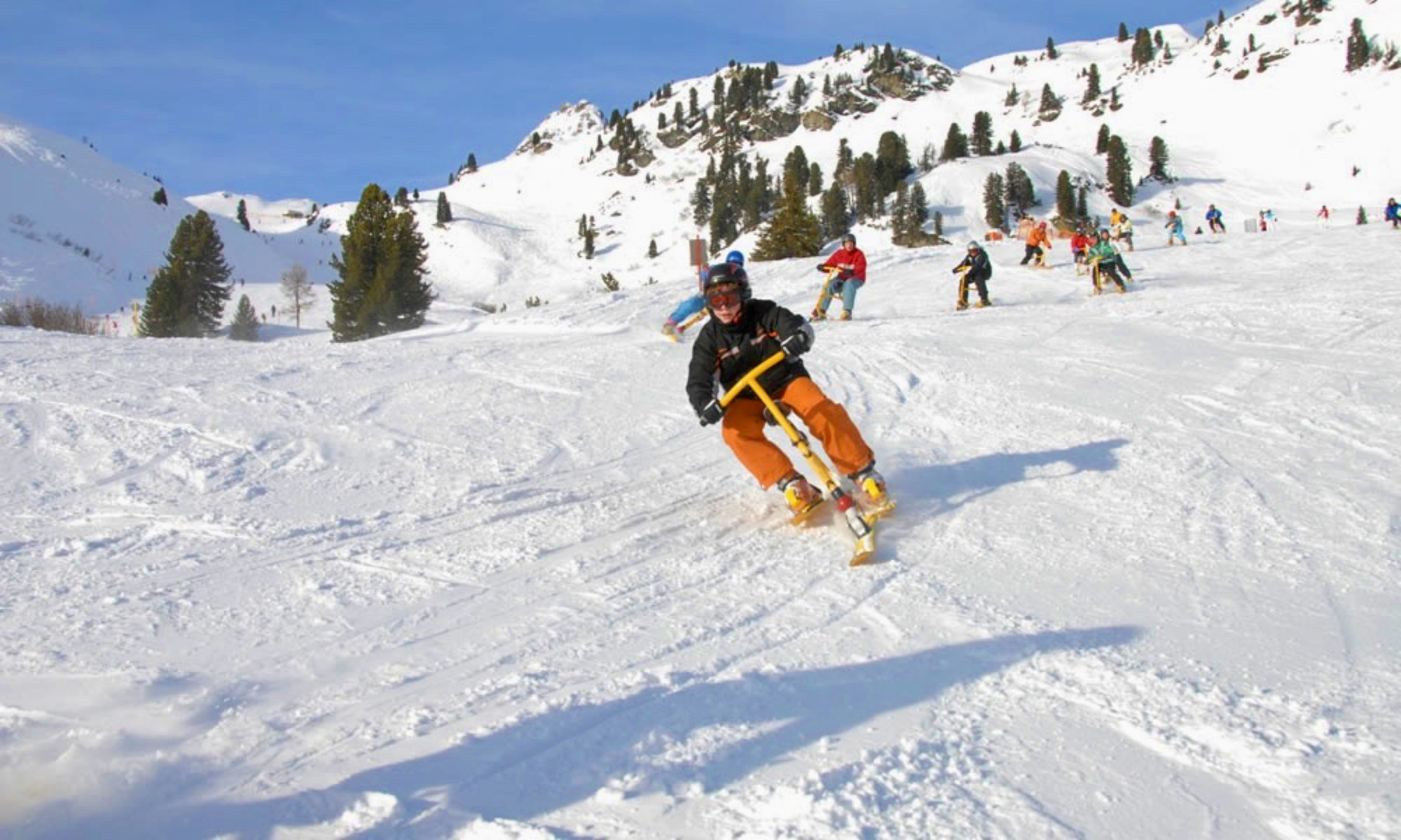 Snowbikers on snowy slopes.