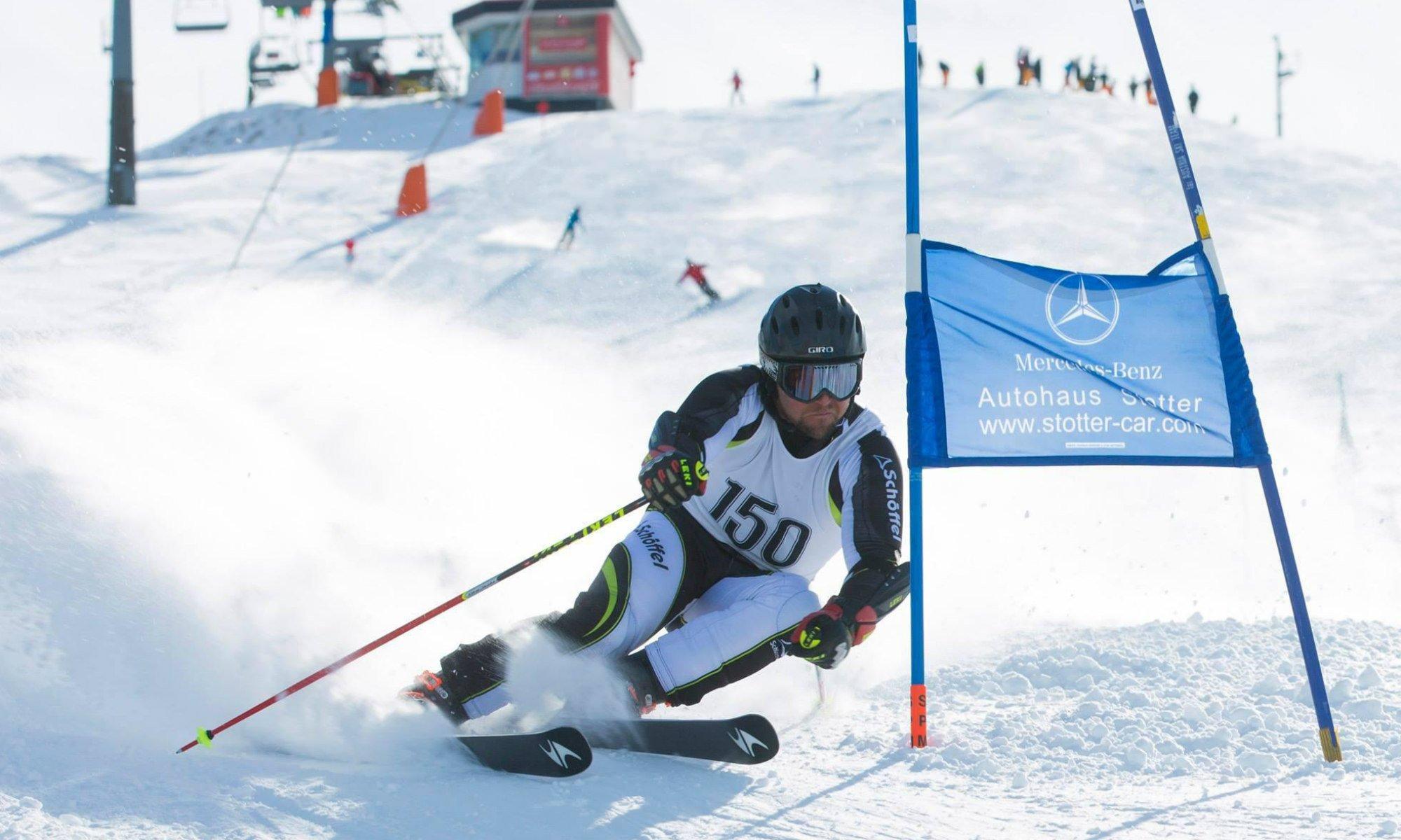 A skier sliding down a race slope.