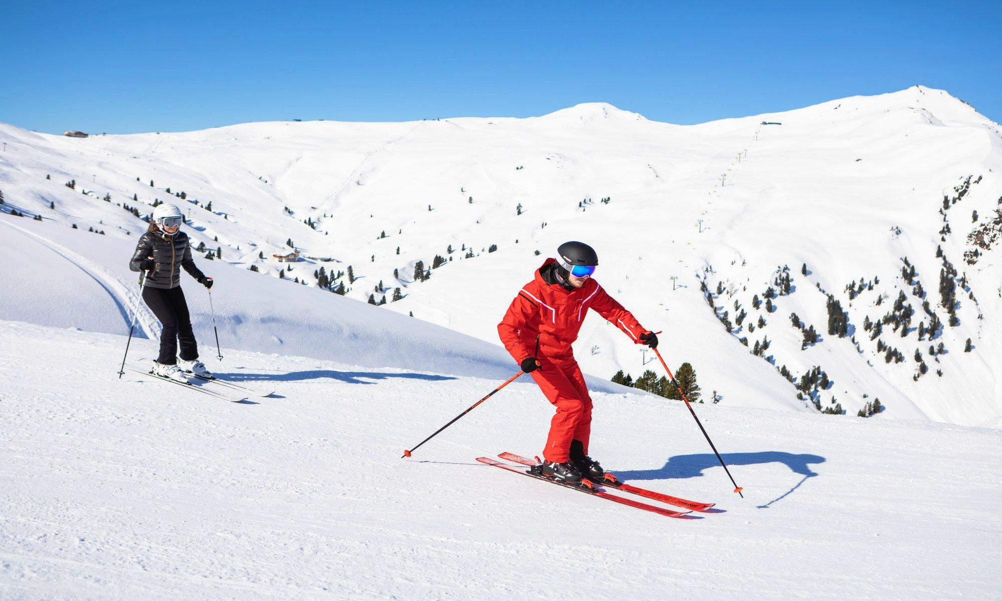 A ski instructor and his pupil on the slopes
