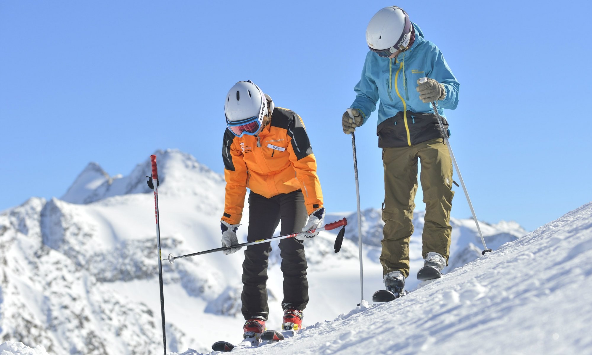 An adult skier during a beginners course.