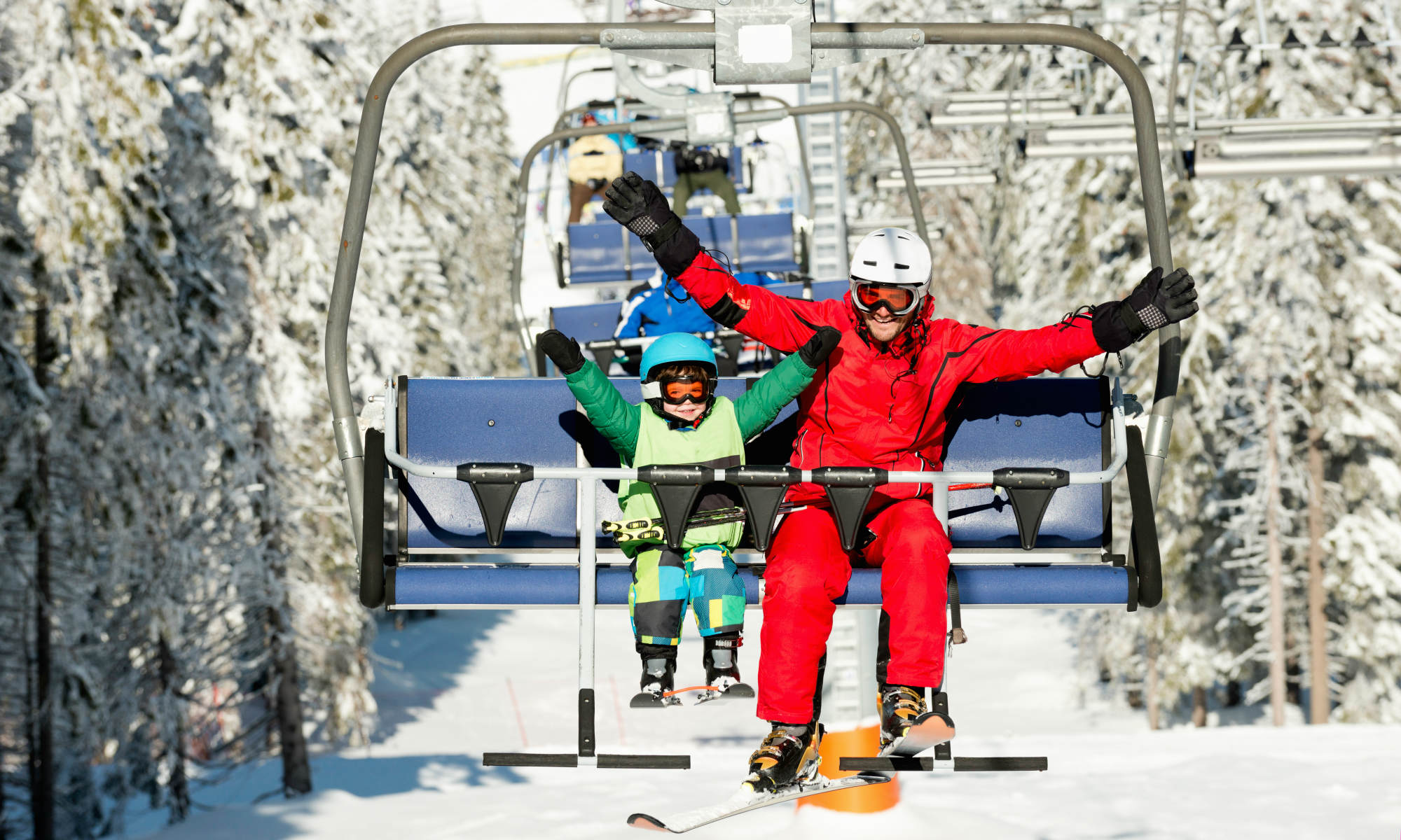 A child and a private instructor during a lift ride.