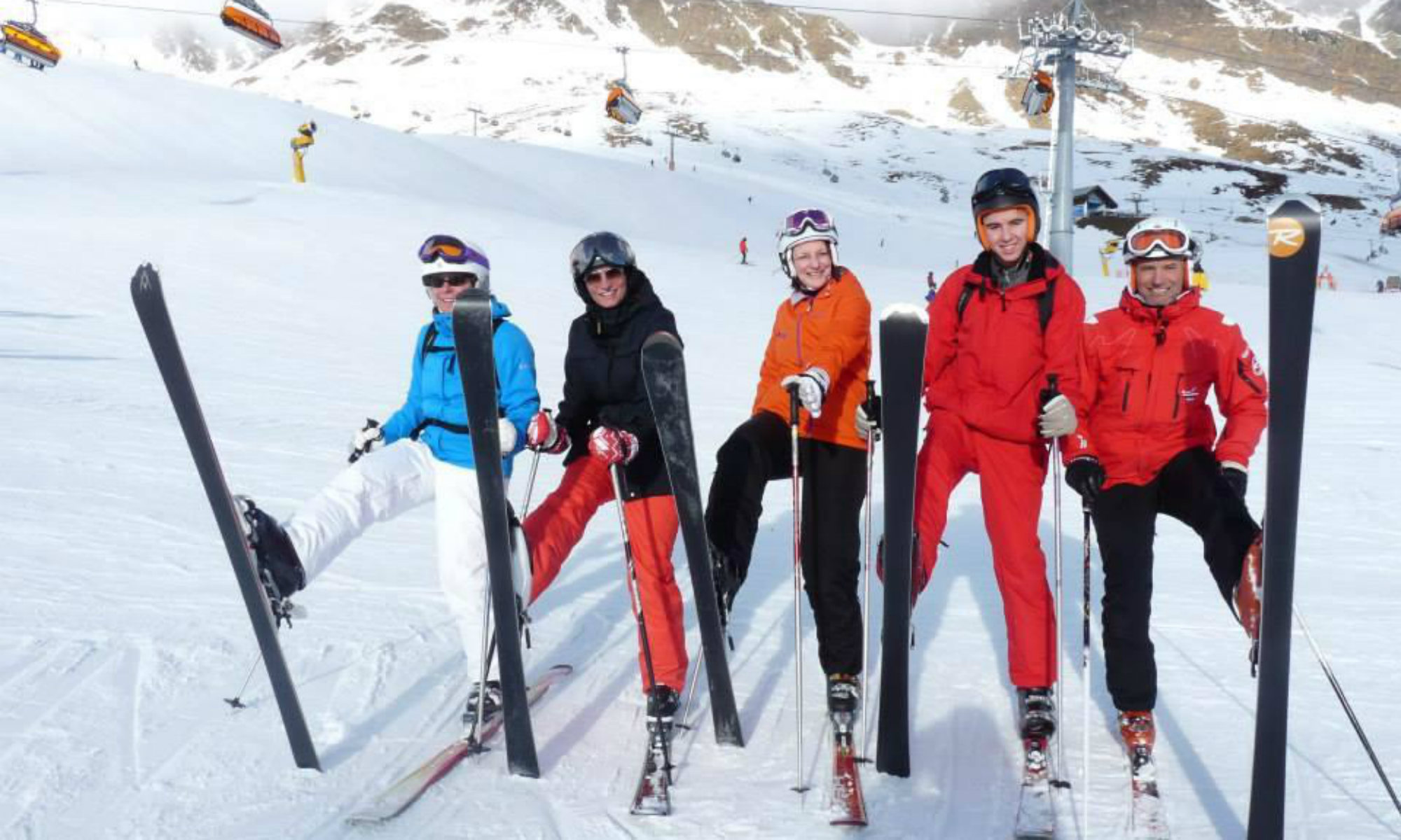 Participants of a ski lesson for adults having fun.