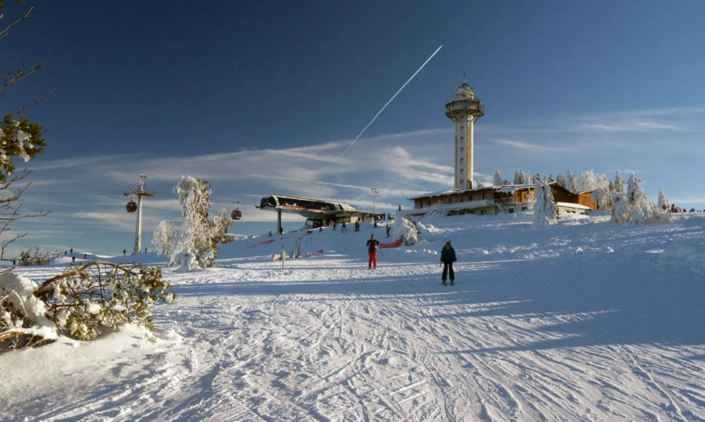 """Willingen mountain station with the """"Hochheideturm"""" tower in the back."""