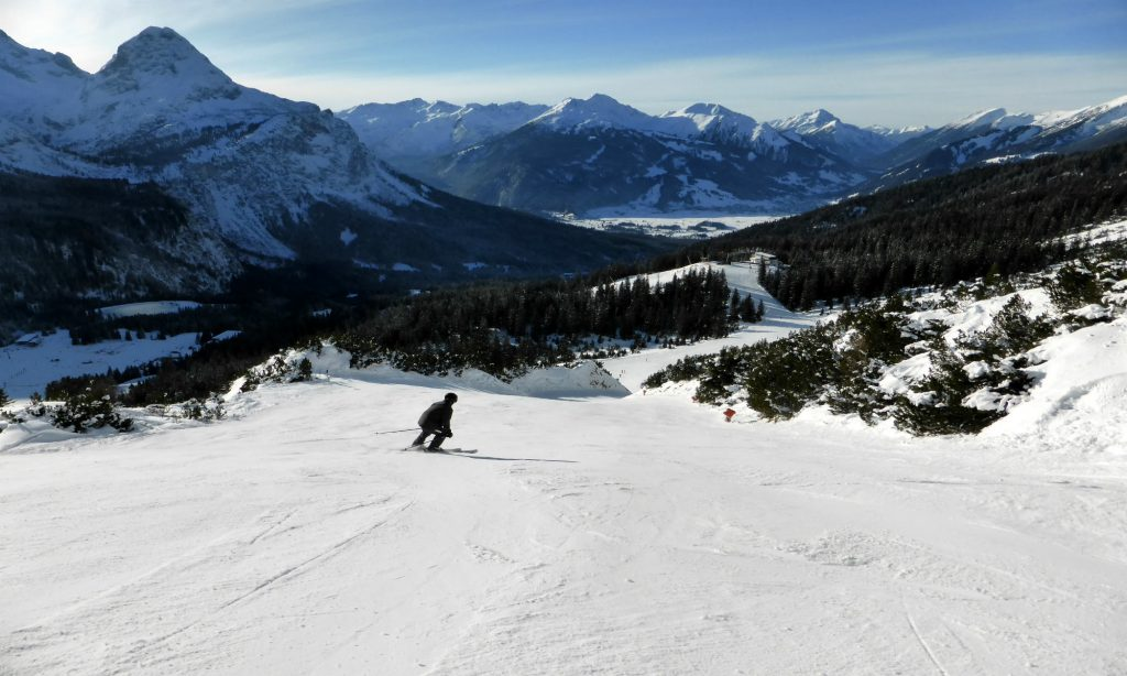 Panorama view over the ski resort Ehrwalder Alm, 1 person skiing down.