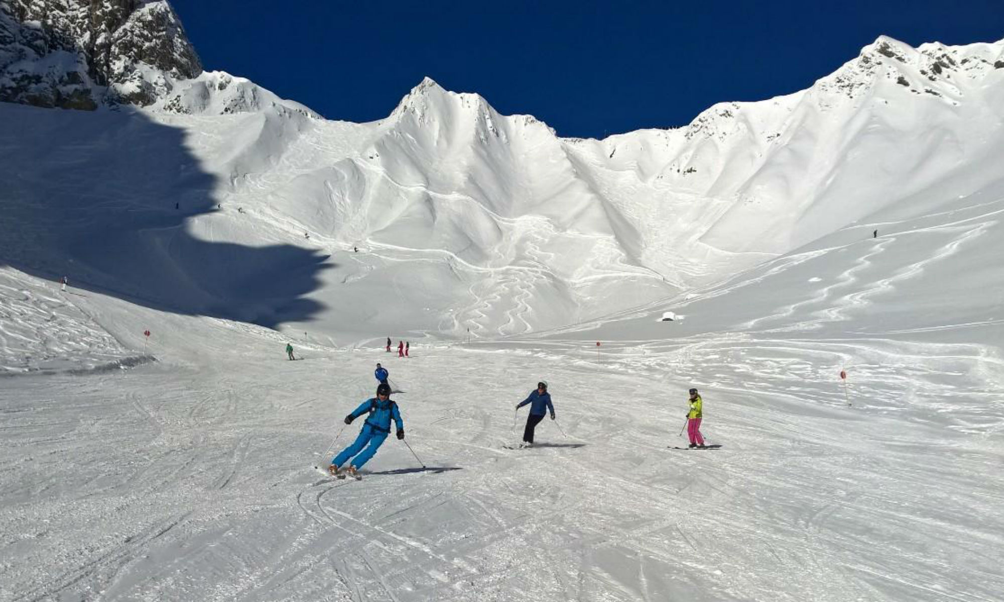 3 skiers on a beginner friendly slope in the ski resort of St Anton.
