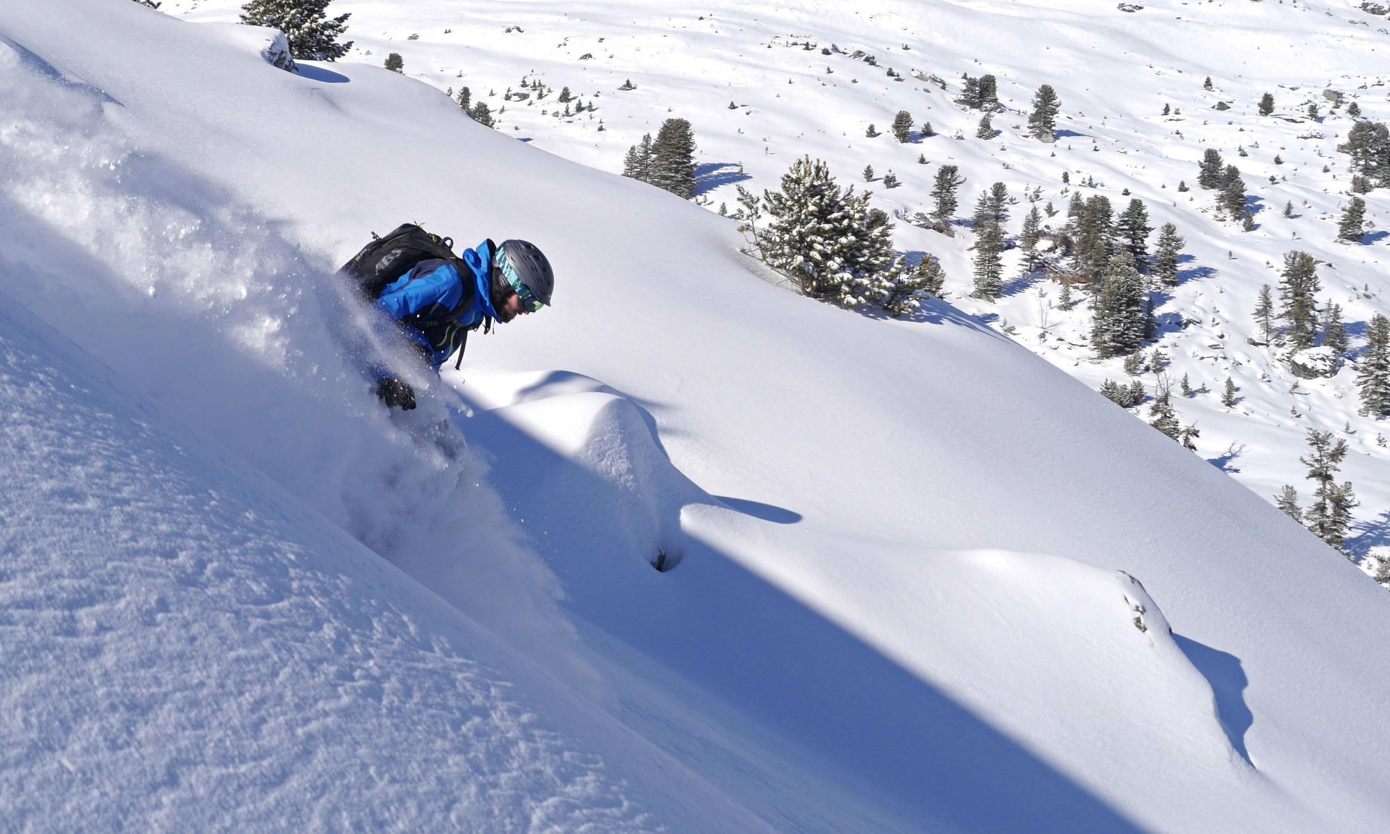 A skier is freeriding on a piste in the ski area of St Anton.