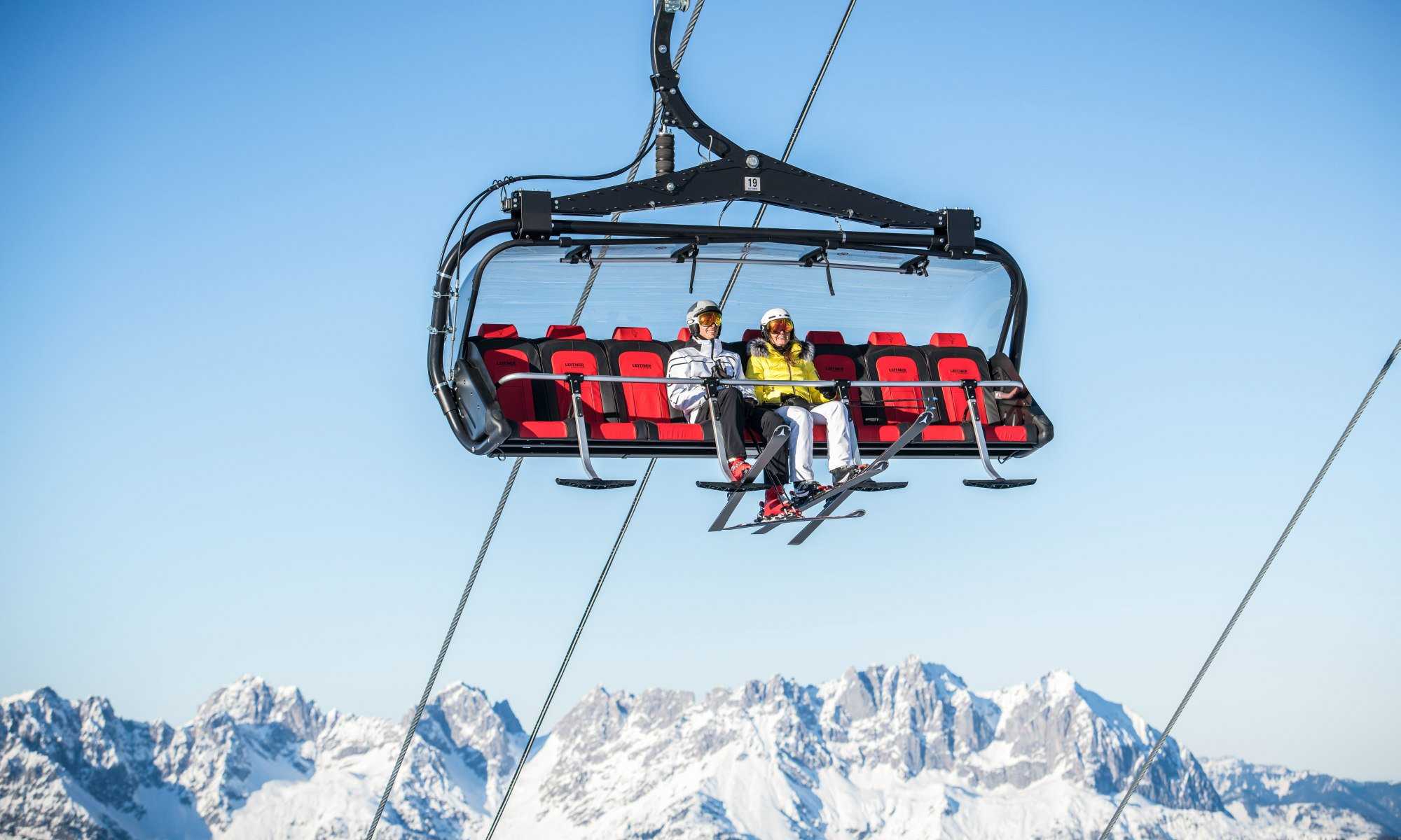 Taking the chairlift in Kitzbühel gives you the opportunity to enjoy a beautiful view of the Alps.