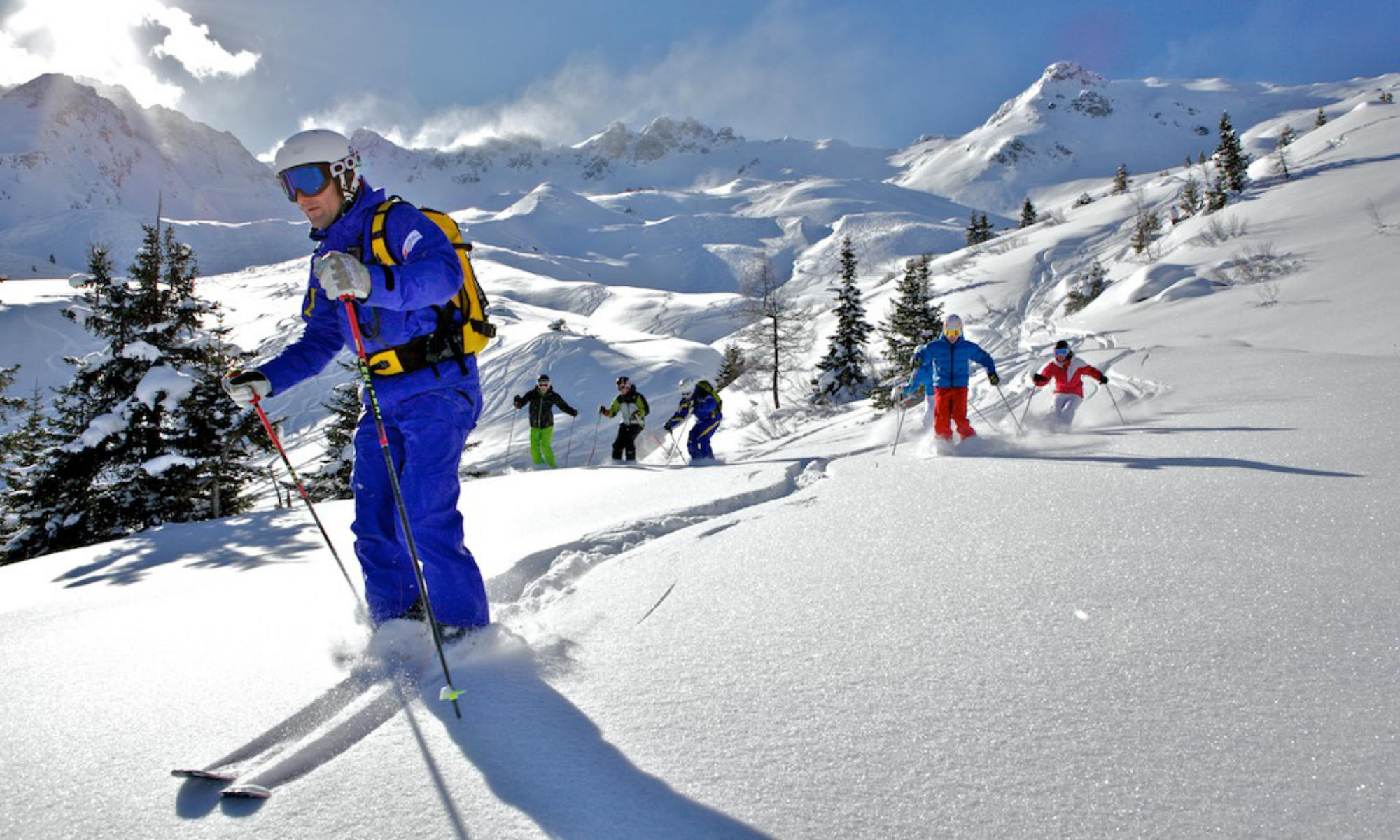 Ski instructors with a group of adults during a freeride lesson in the Gasteinertal valley.
