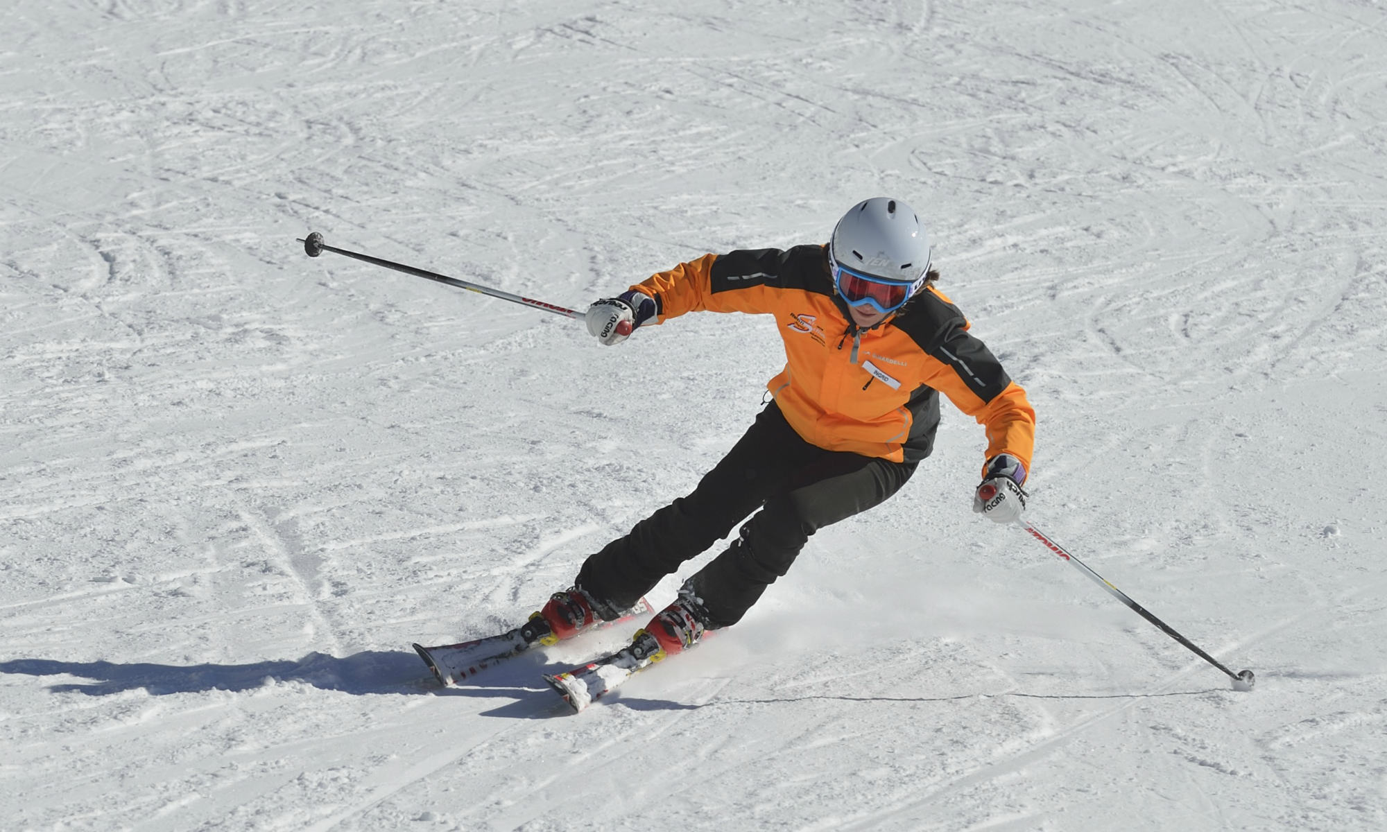 A skier demonstrates alpine skiing with the right body posture.