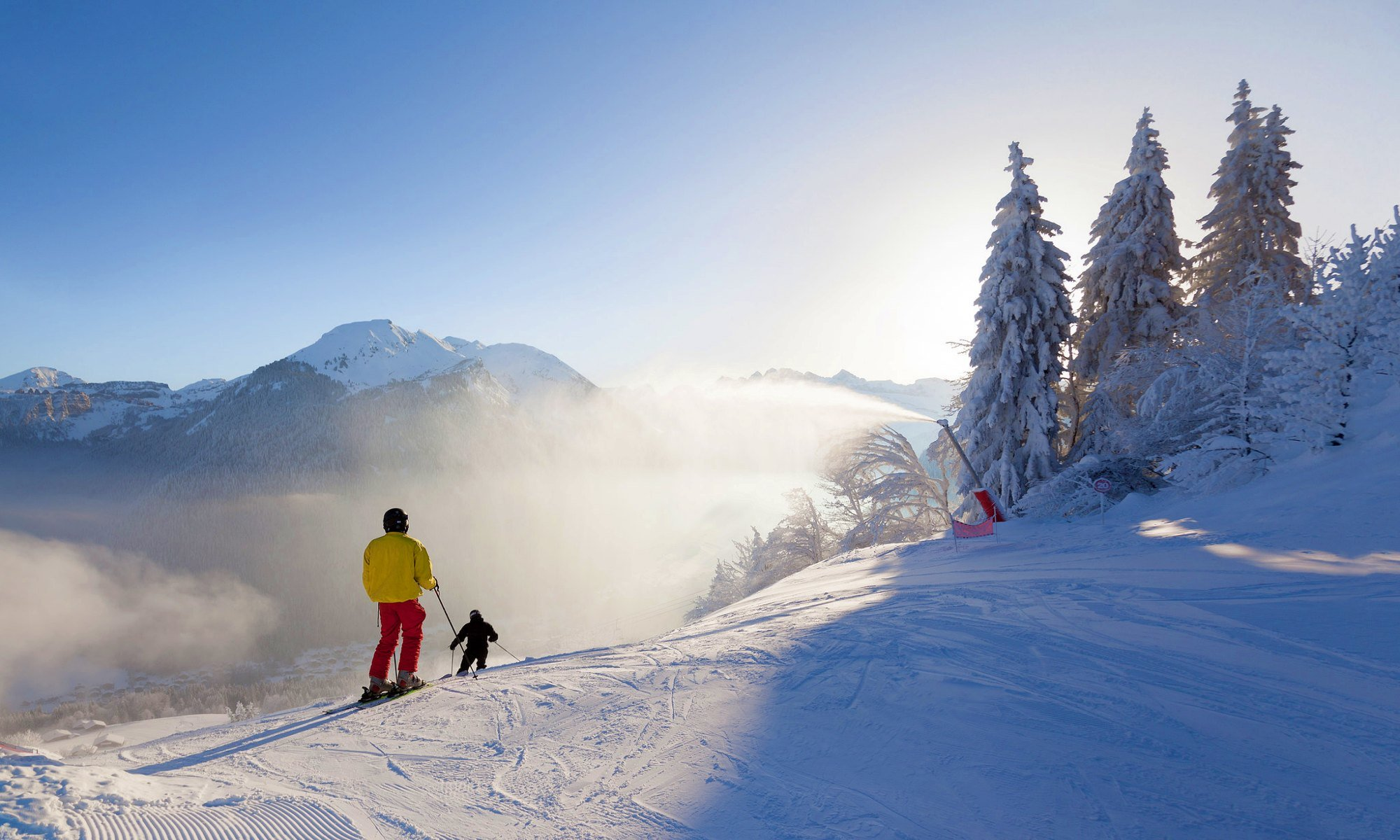 Skiers on the sunlit slopes of Morzine.