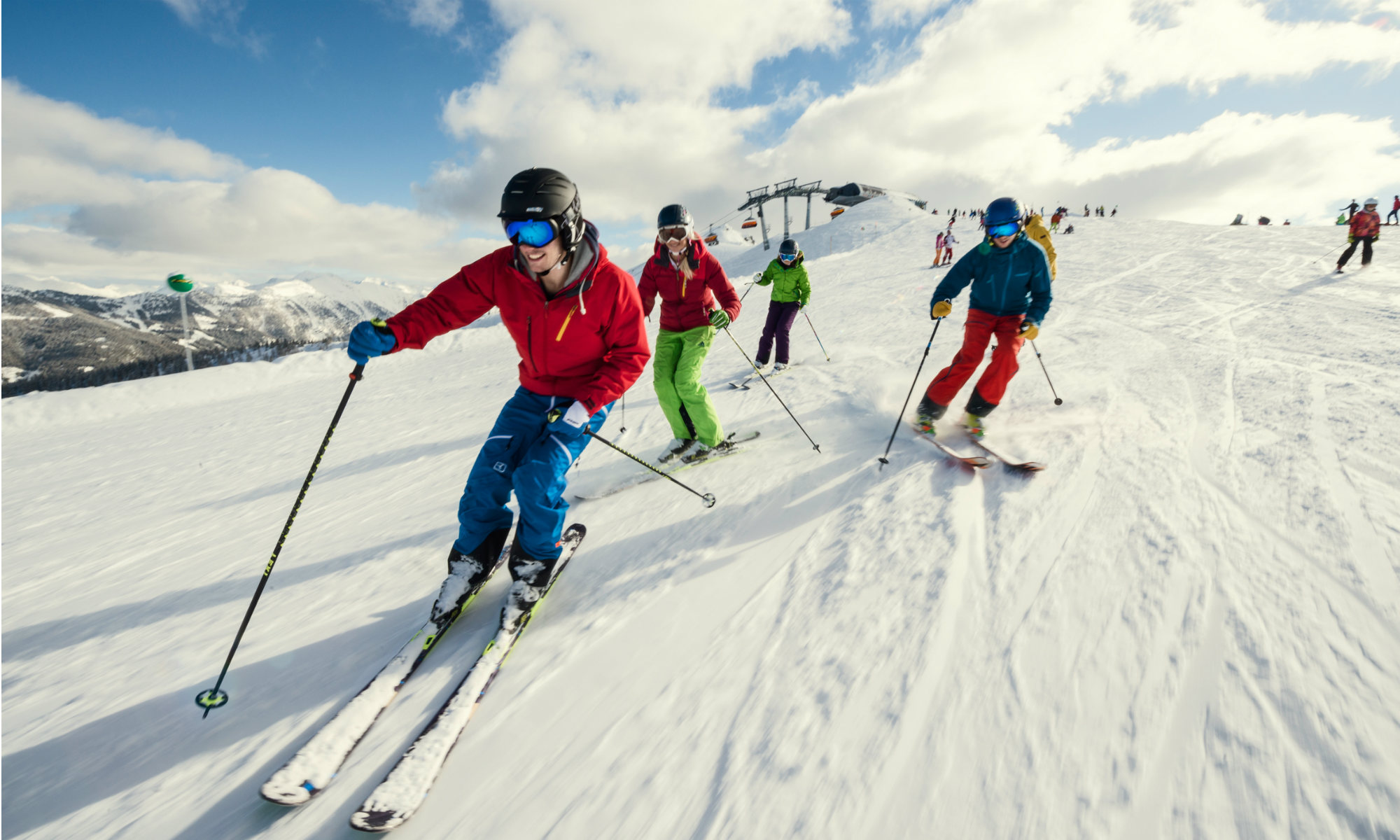 A group of skiers gliding down the slopes in Flachau.
