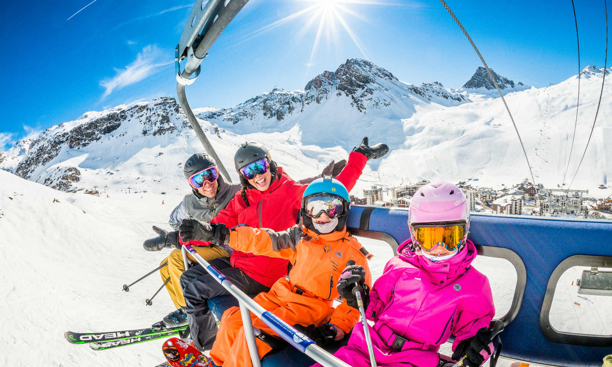 A happy family on the chairlift in the ski resort Tignes.