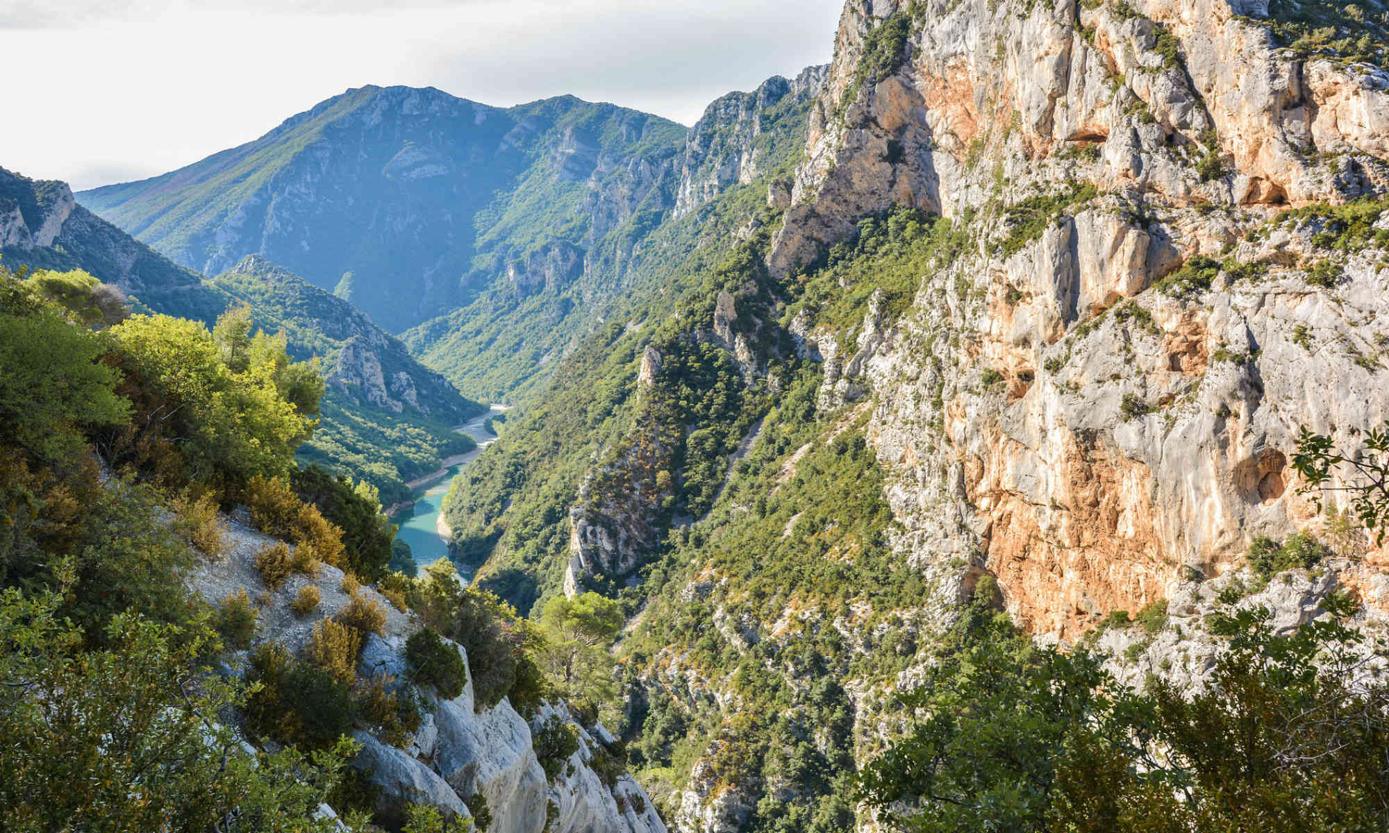 A view of the Verdon river winding its way through the depths of the gorge.