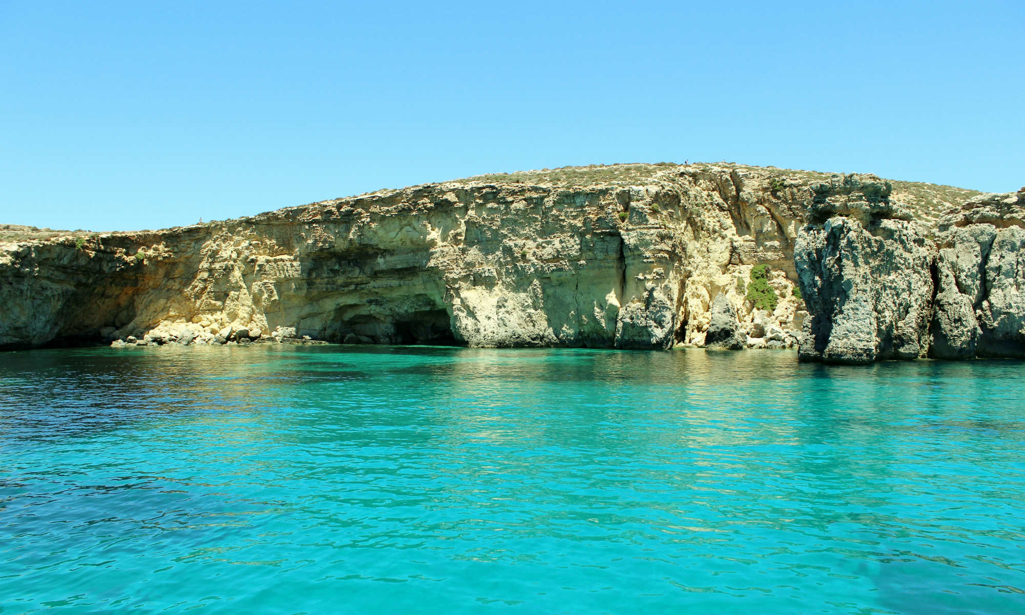 A beautiful lagoon where the turquoise waters of the Mediterranean meet Gozo's cliff edges.