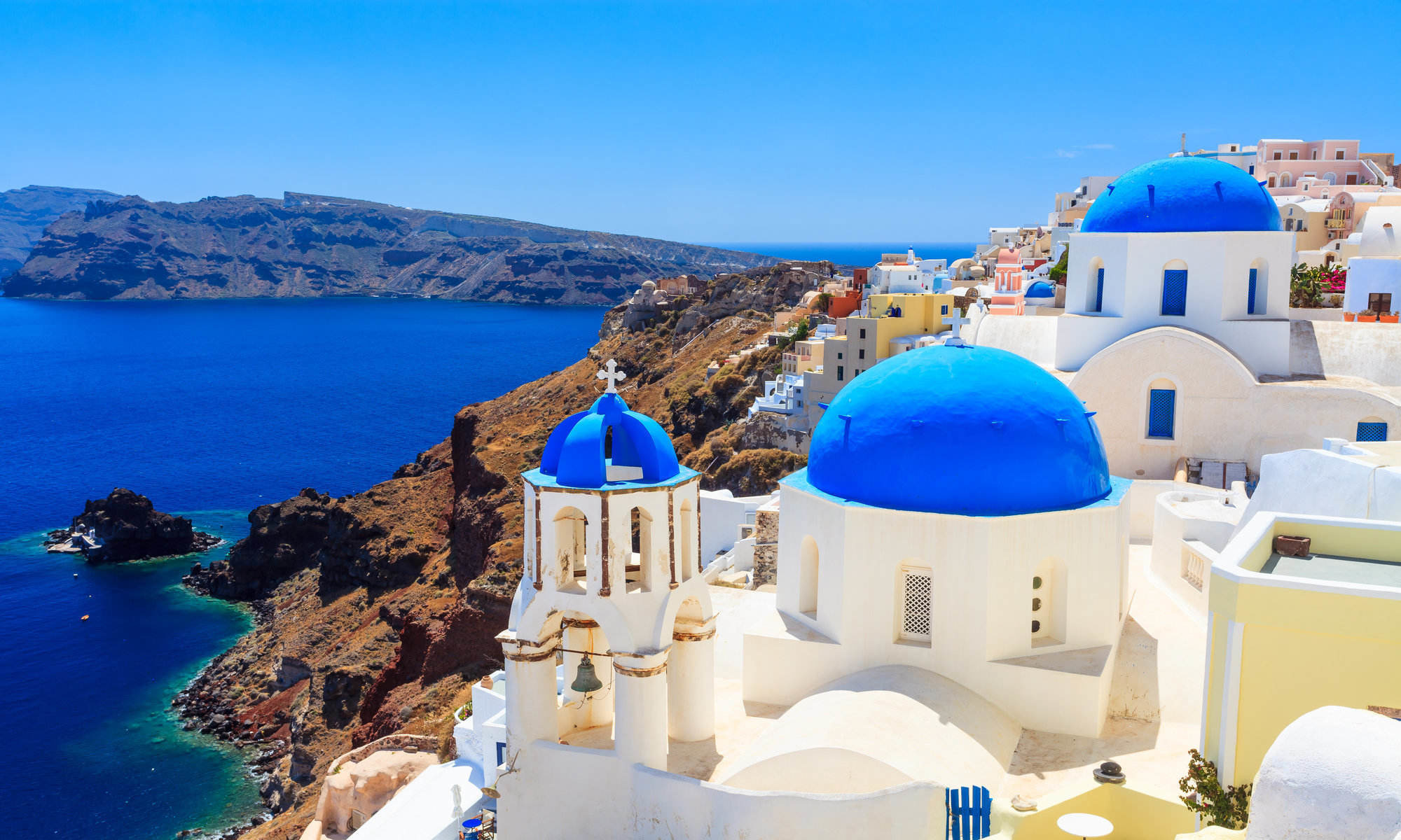 Blue-domed churches on the Caldera at Oia on the Greek Island of Santorini.