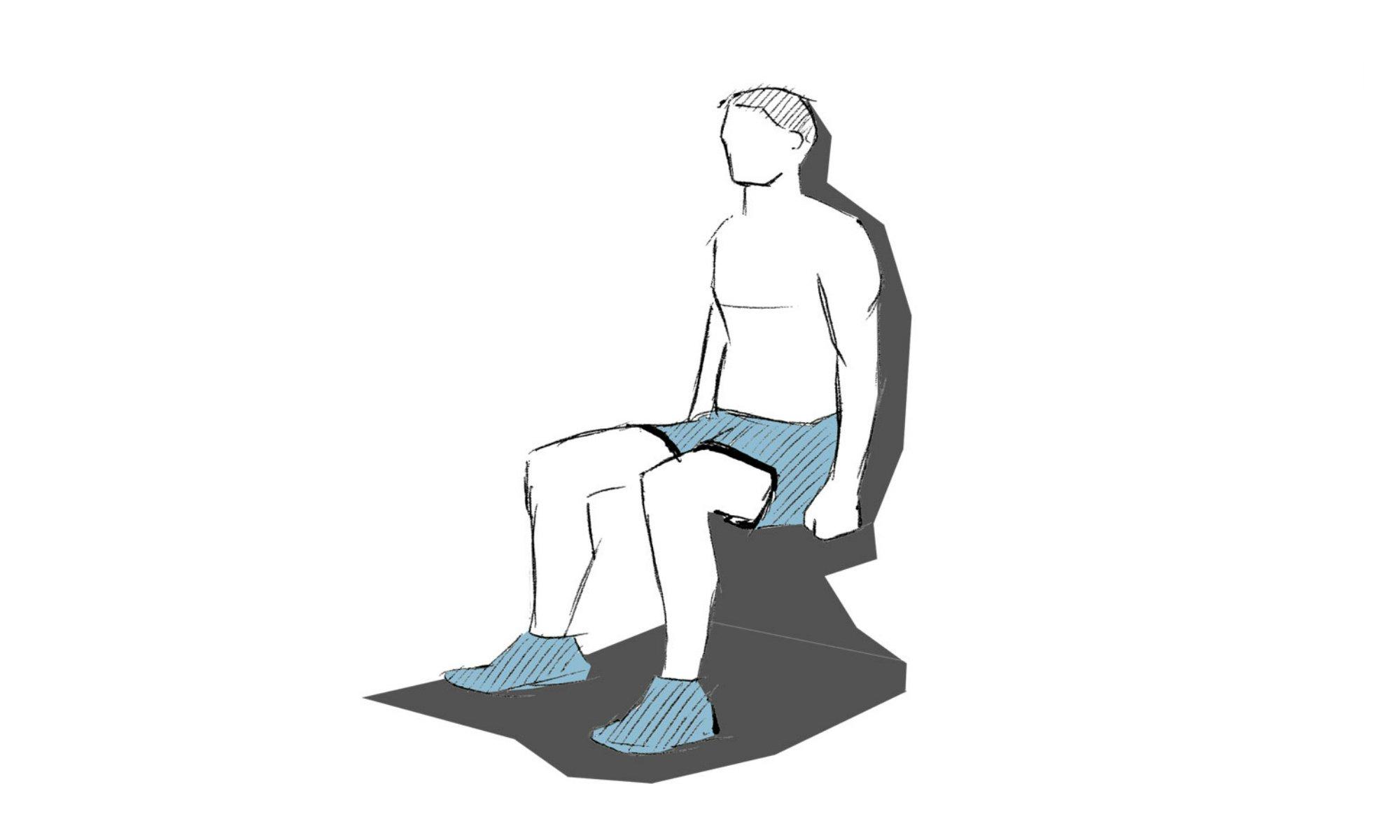 De wall sit is een oefening waarbij je met je rug tegen de muur zit.