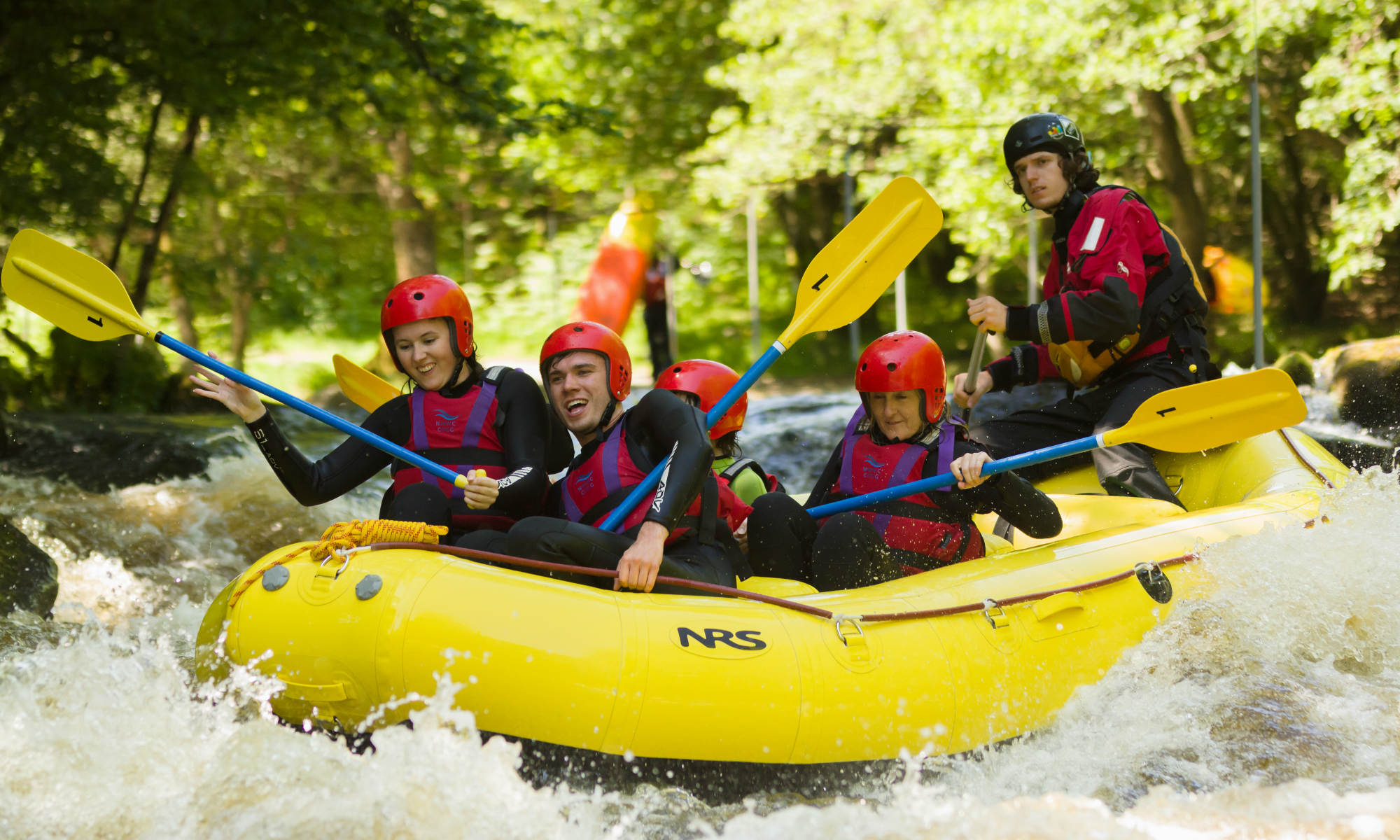 A group of people rafting on the River Tryweryn in North Wales.