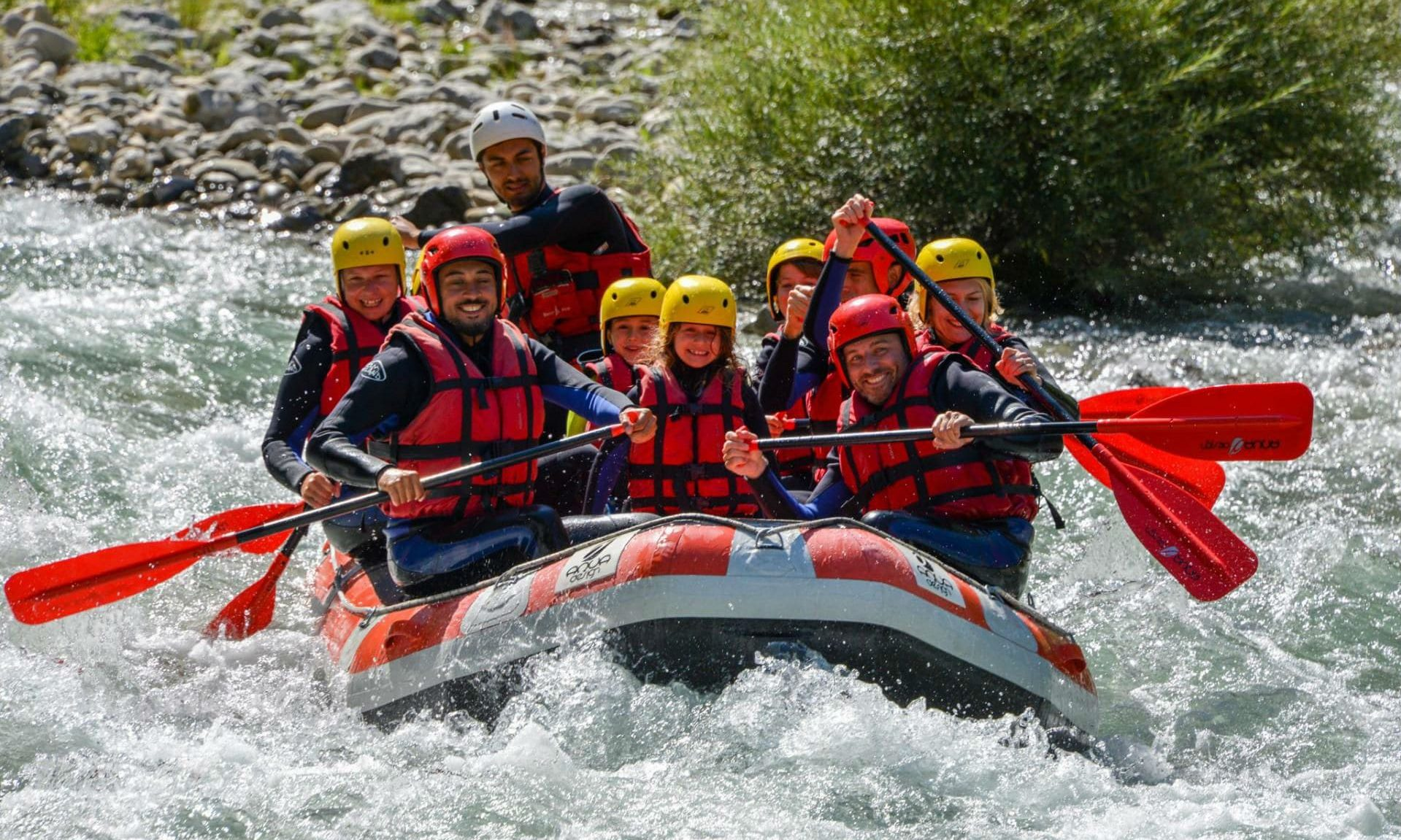 A group of people enjoying a white water rafting tour on the Verdon River.