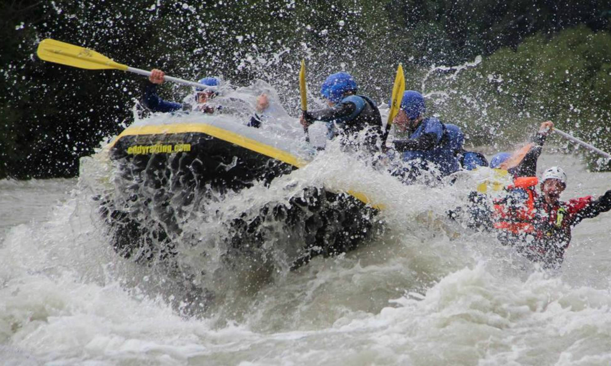 A group of people rafting on the river Isel.
