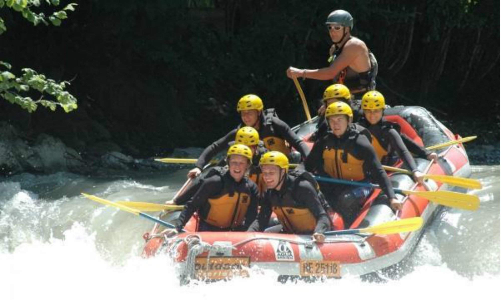 A group of people on a white water rafting tour on the Simme River in the town of Interlaken.