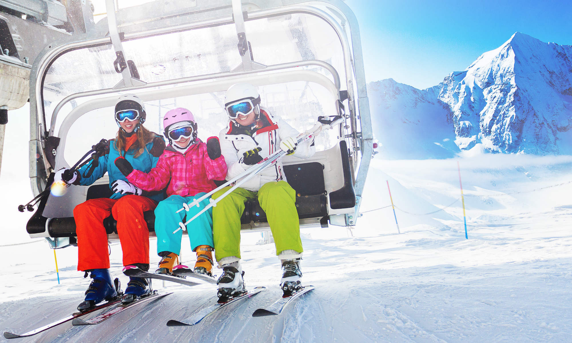 Young skiers in a chairlift.