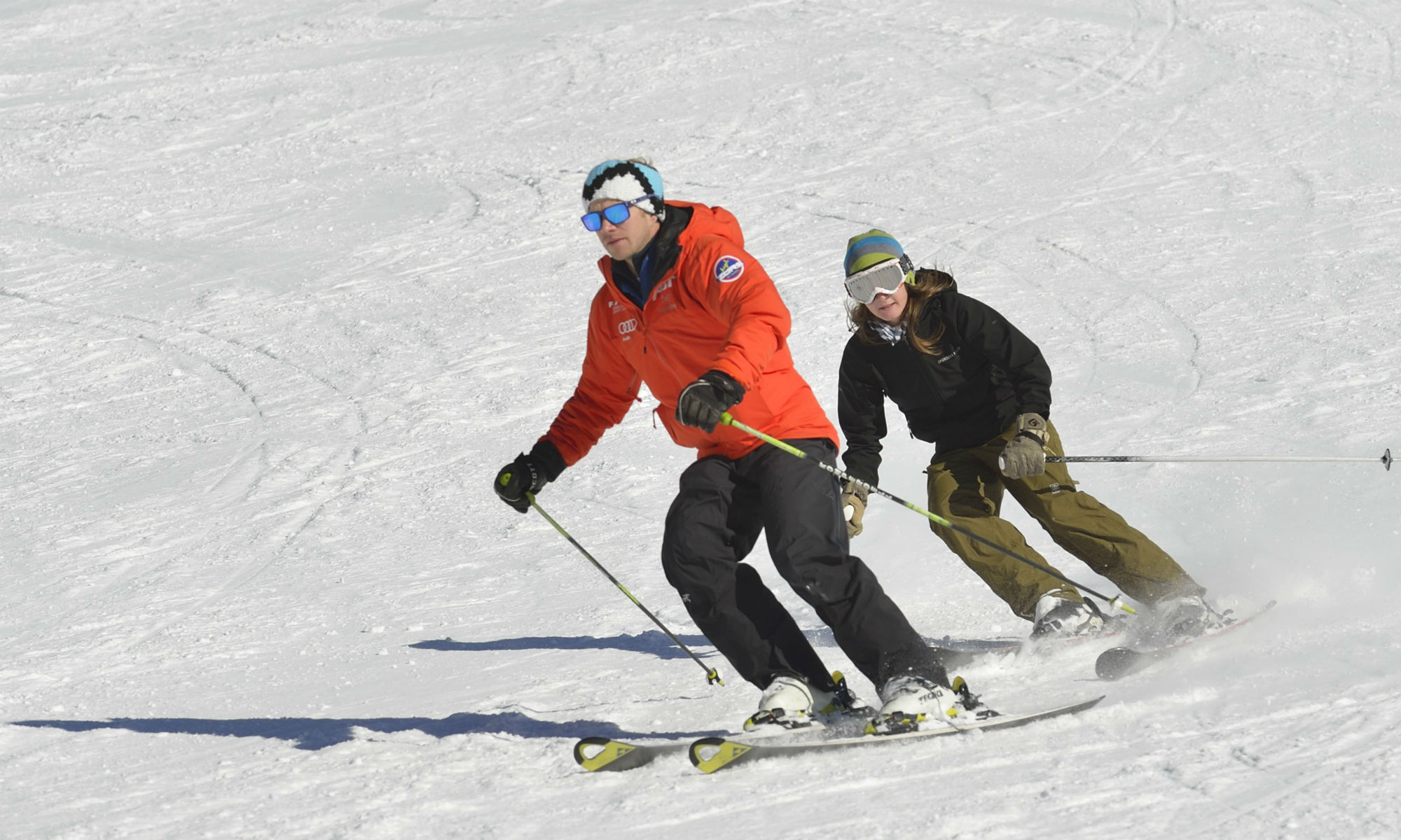 Two returnee skiers practice their technique on the slopes.