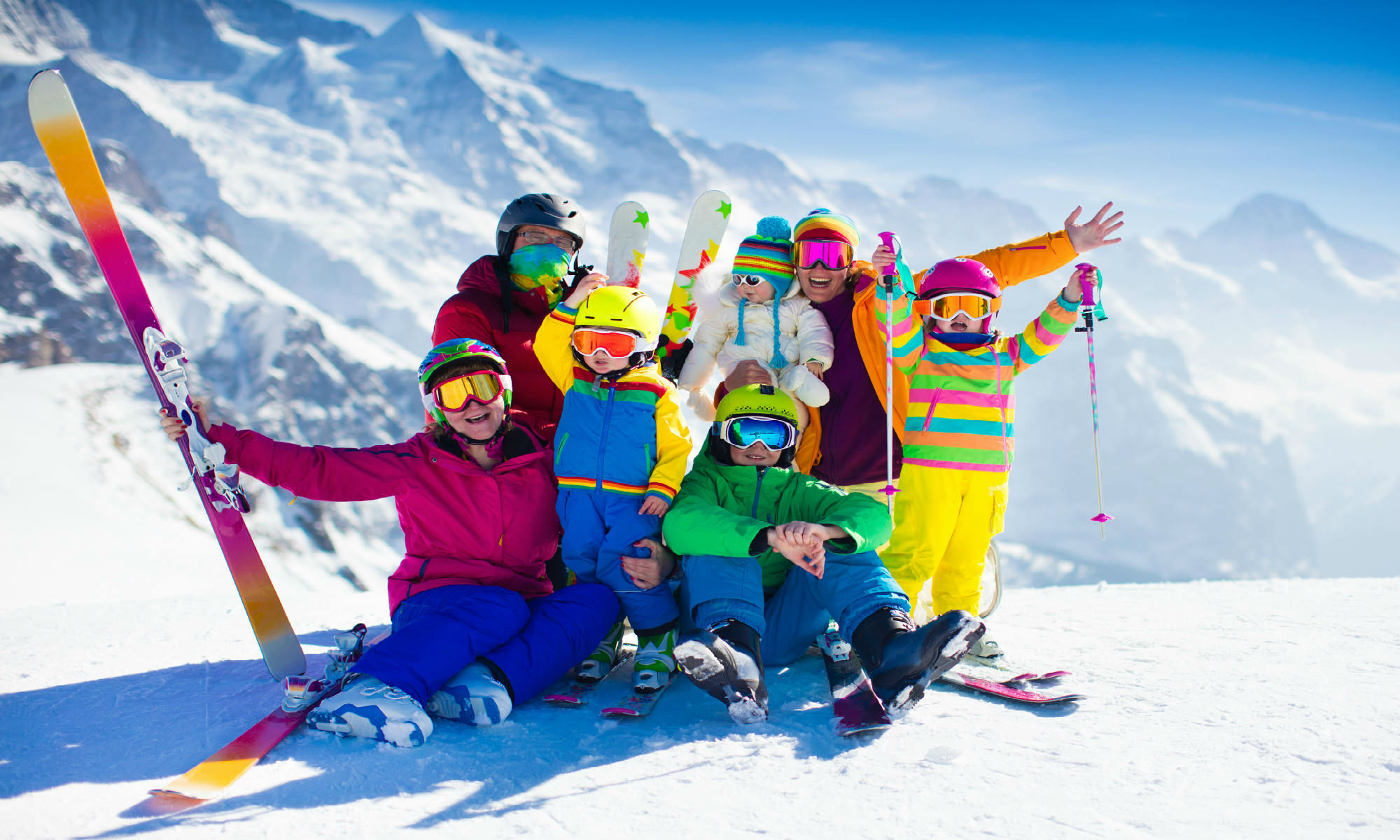A family of skiers on a slope.