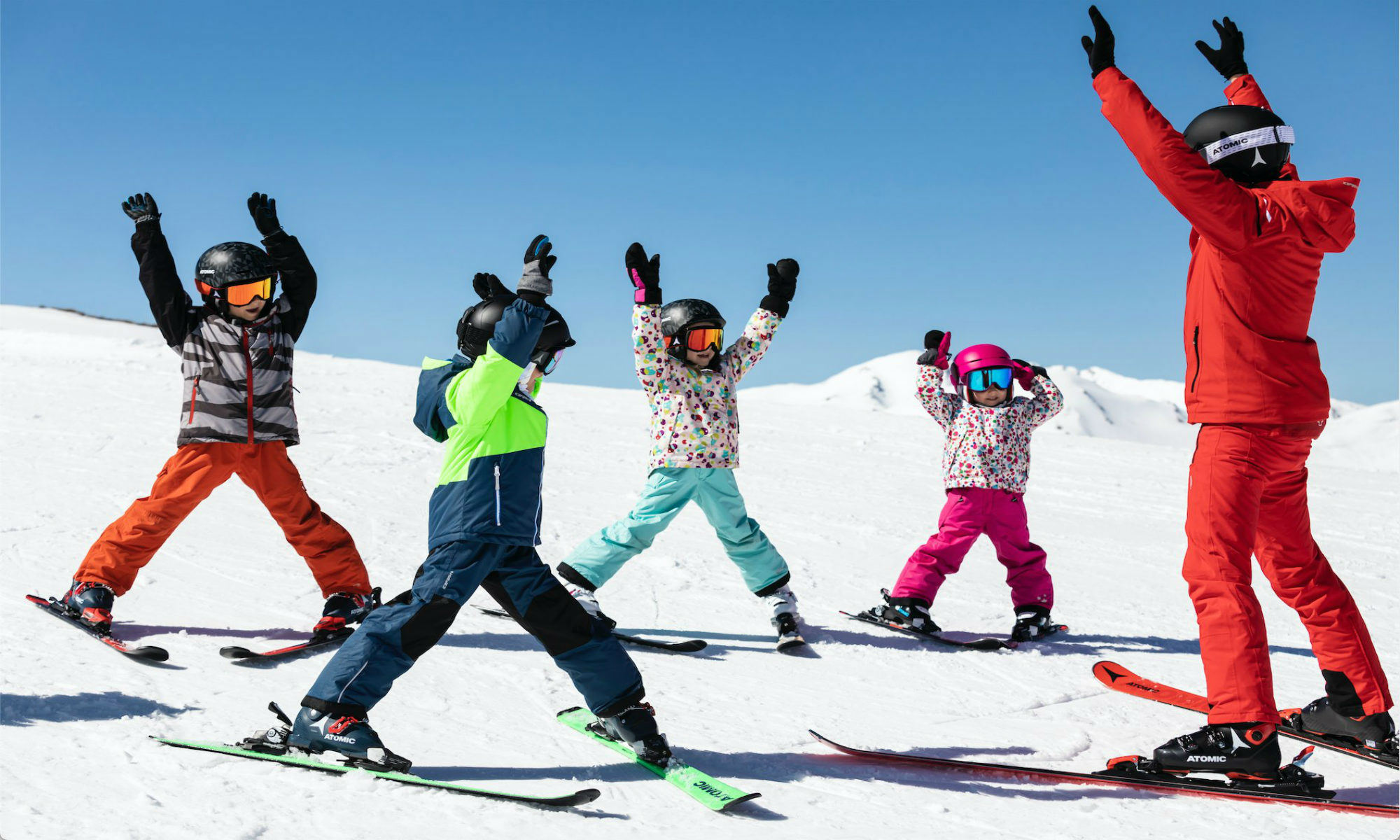 Kids doing exercises with their ski instructor during a group ski lesson in Tignes.
