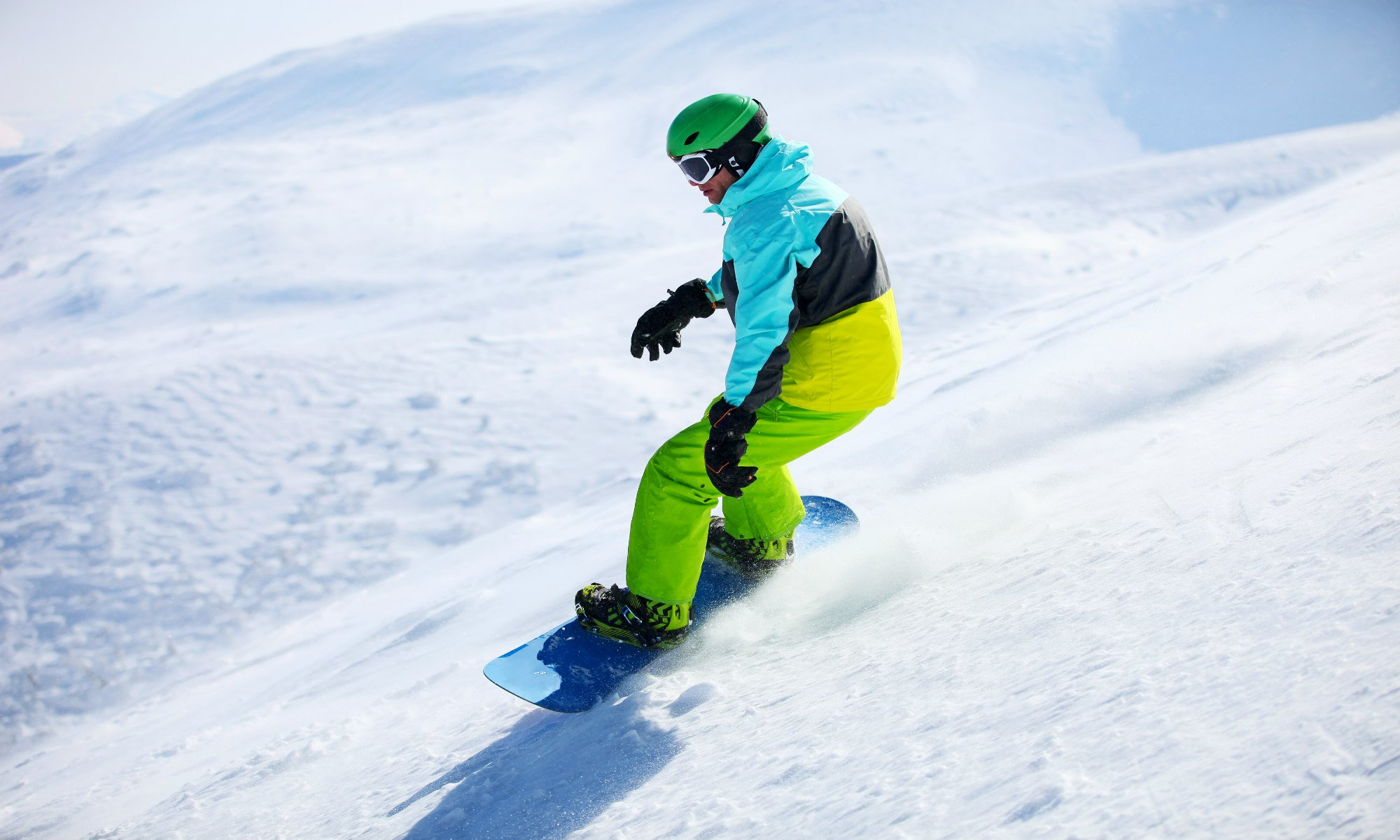 Snowboarder riding on off-piste terrain.