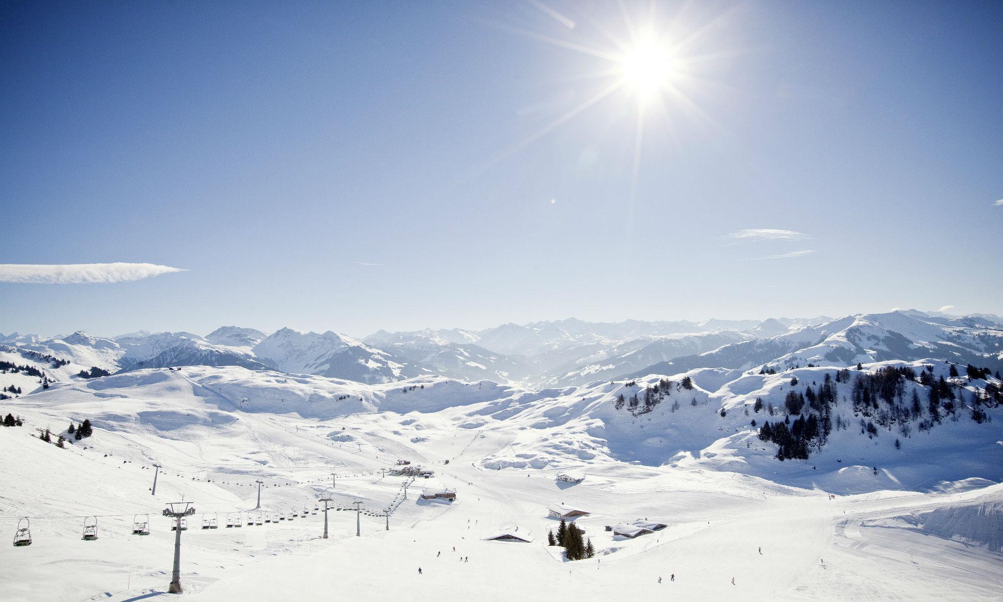 Sunny mountain view of Kitzbühel ski slopes.
