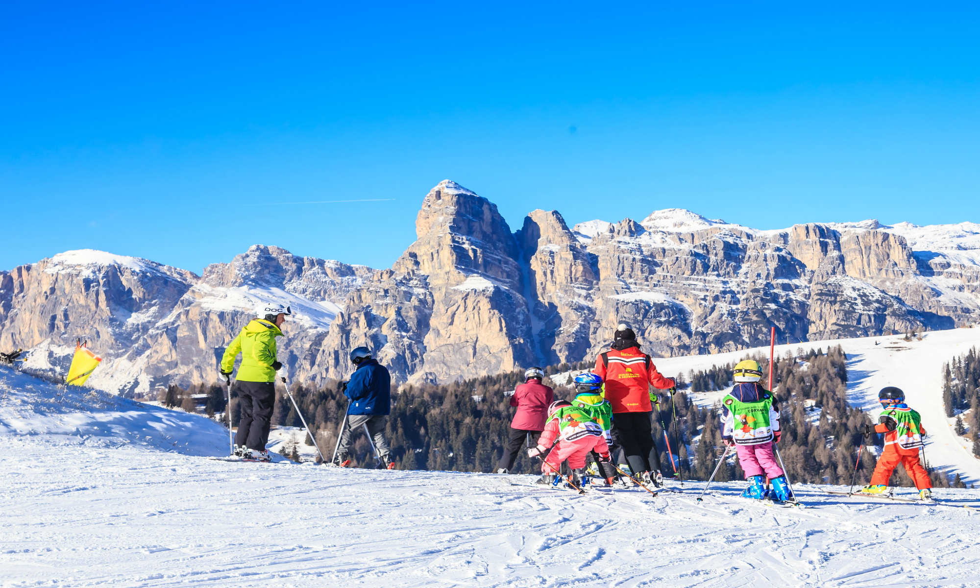 Young skiers having a skiing lesson on a high slope in Val Gardena.