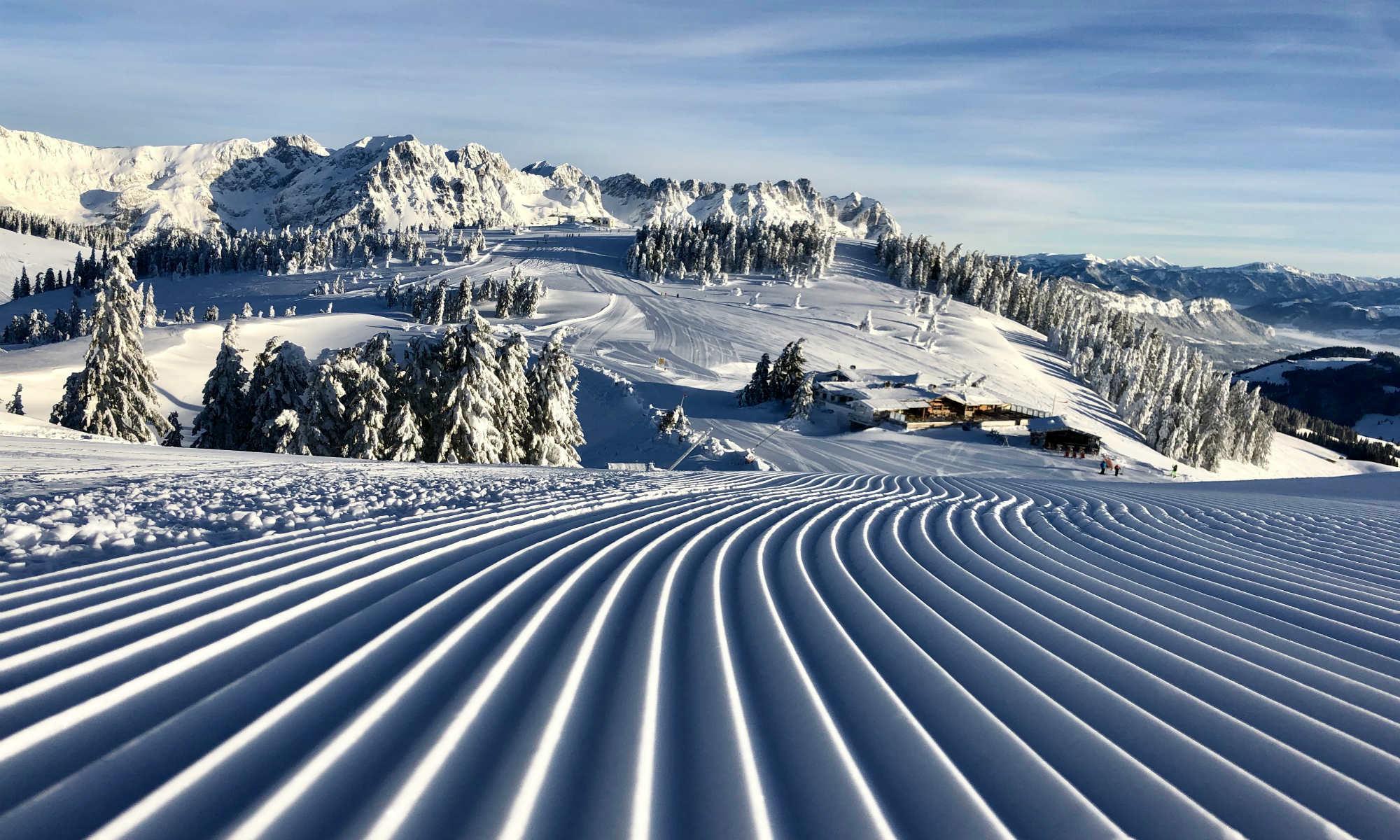 View over perfectly-groomed ski slopes at Söll ski resort.