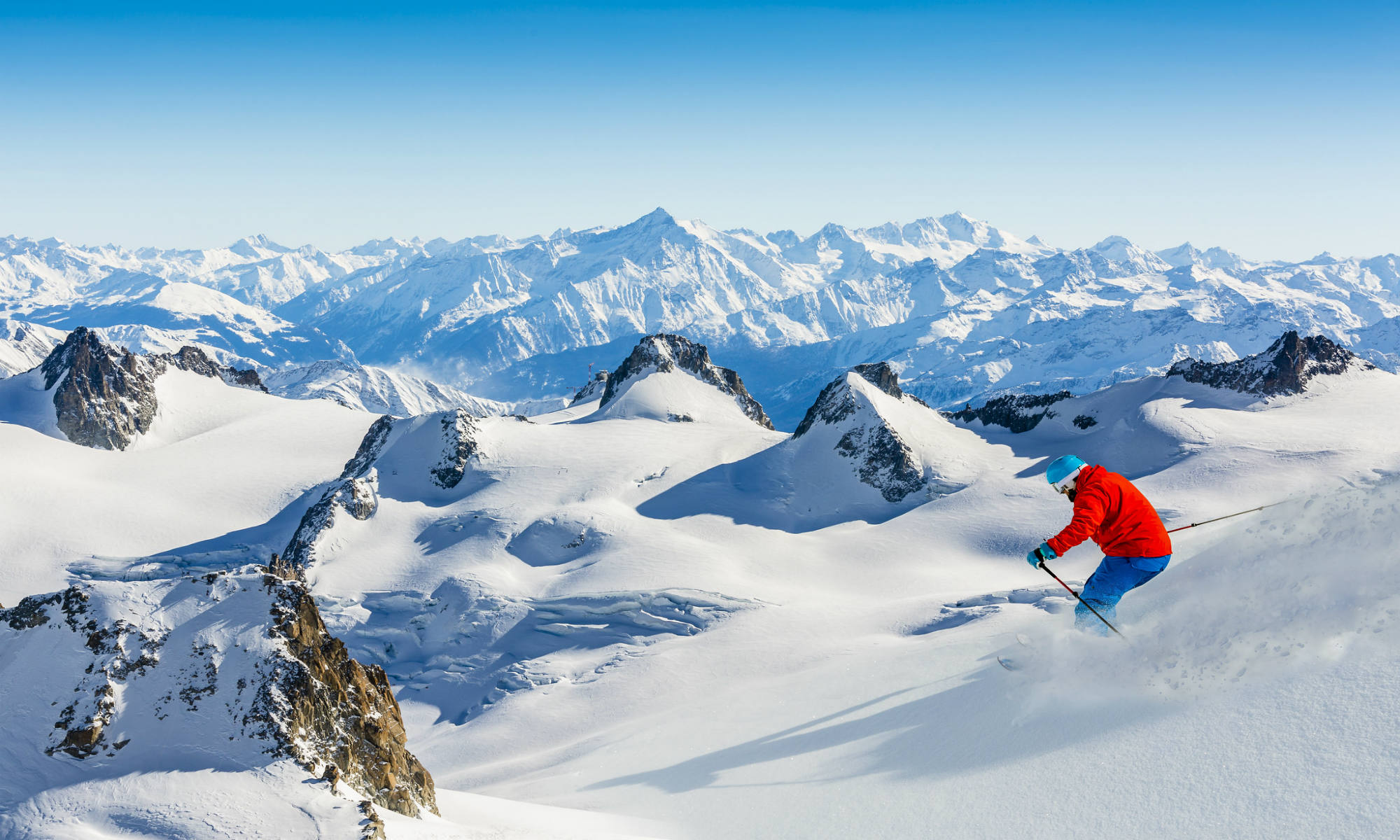 A skier enjoying untouched off-piste terrain, high up the mountains in Chamonix.