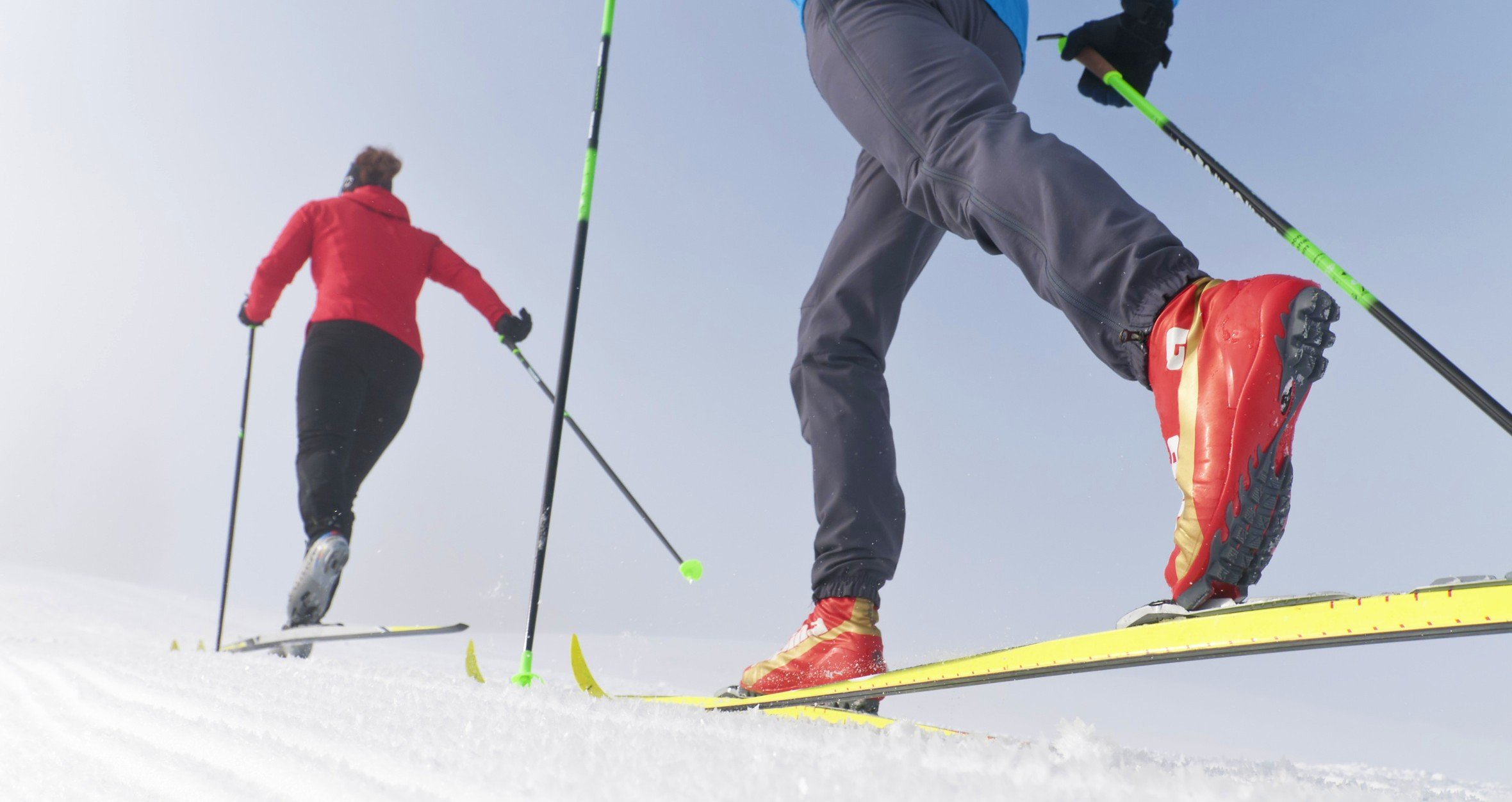 Two skiers go on a ski tour.