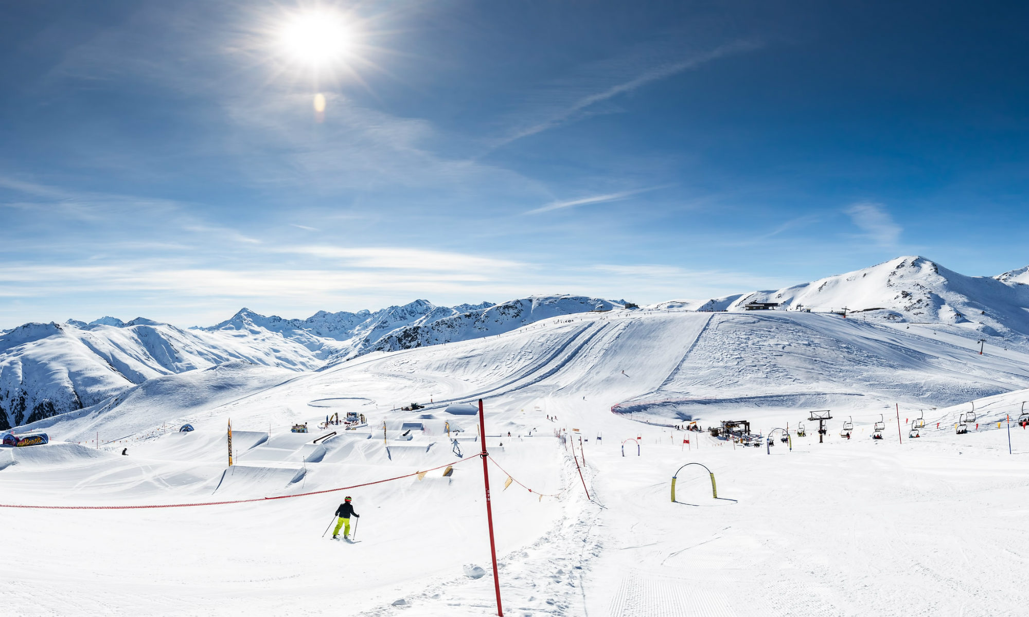 Sunny day view over the snow-sure slopes of Livigno.