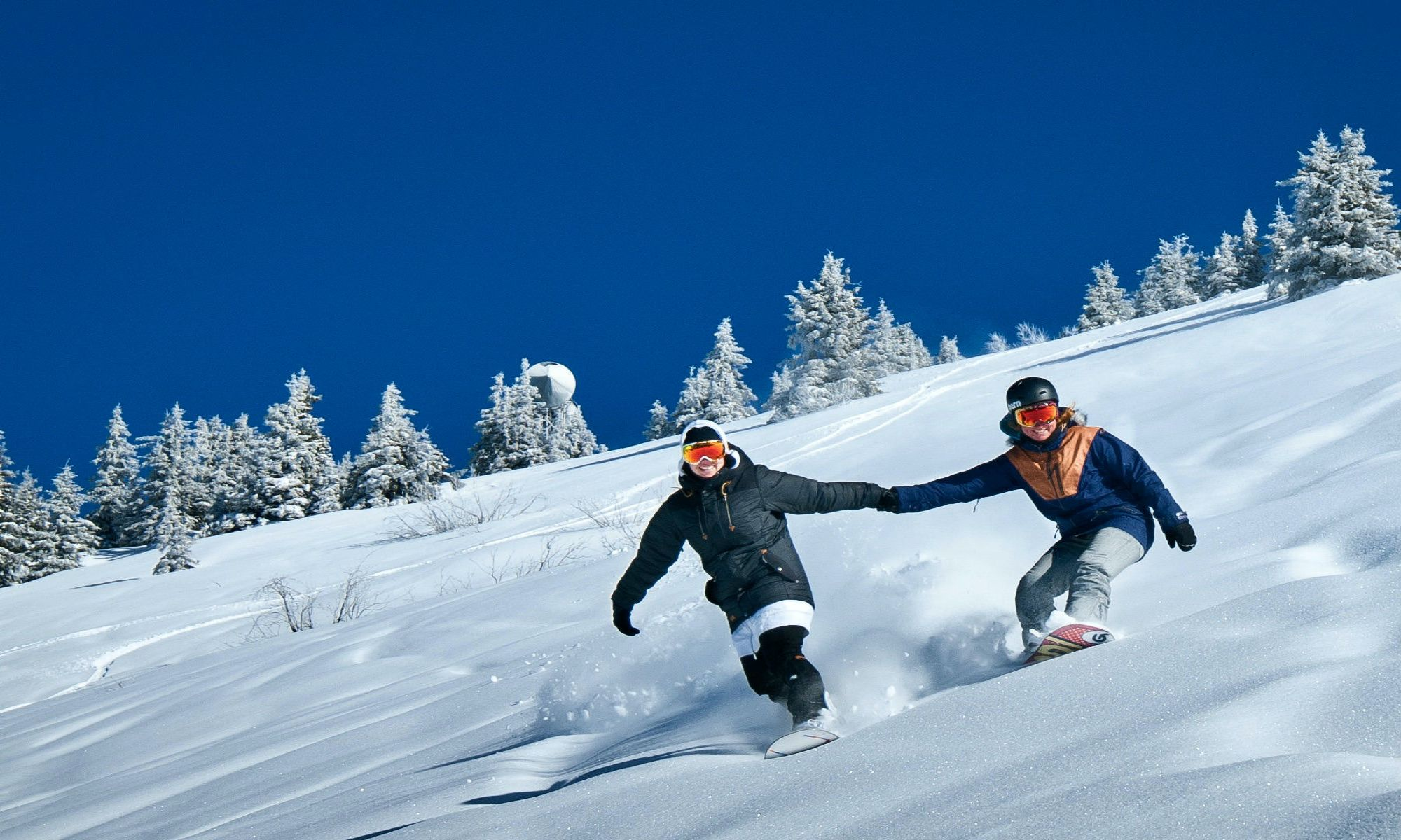 Two snowboarders freeriding on fresh snow at Avoriaz.