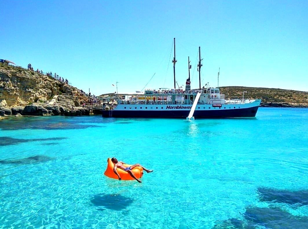 A man relaxes at the blue lagoon in Malta.