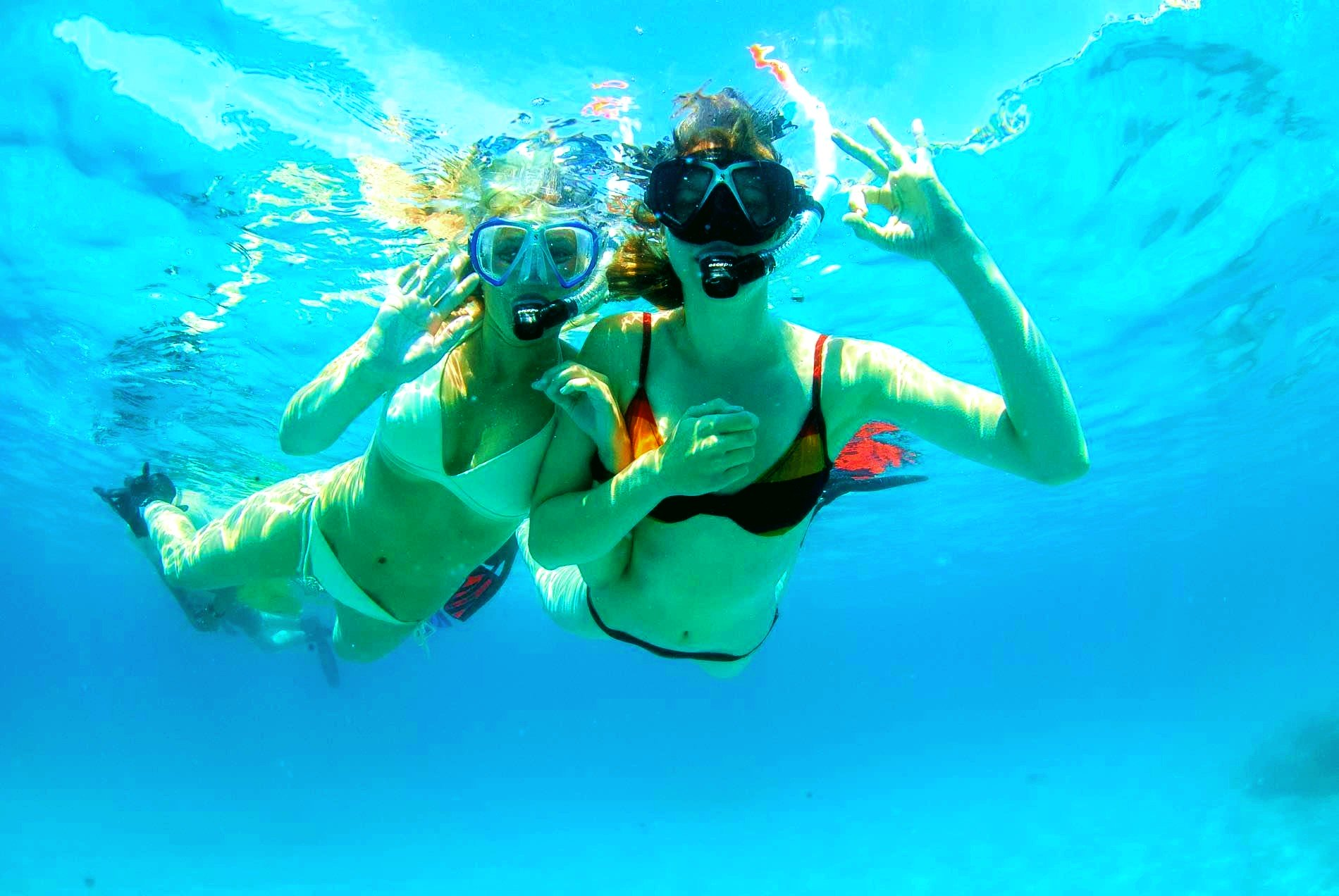 Two girls explore the underwater world of Mallorca on a snorkeling excursion.