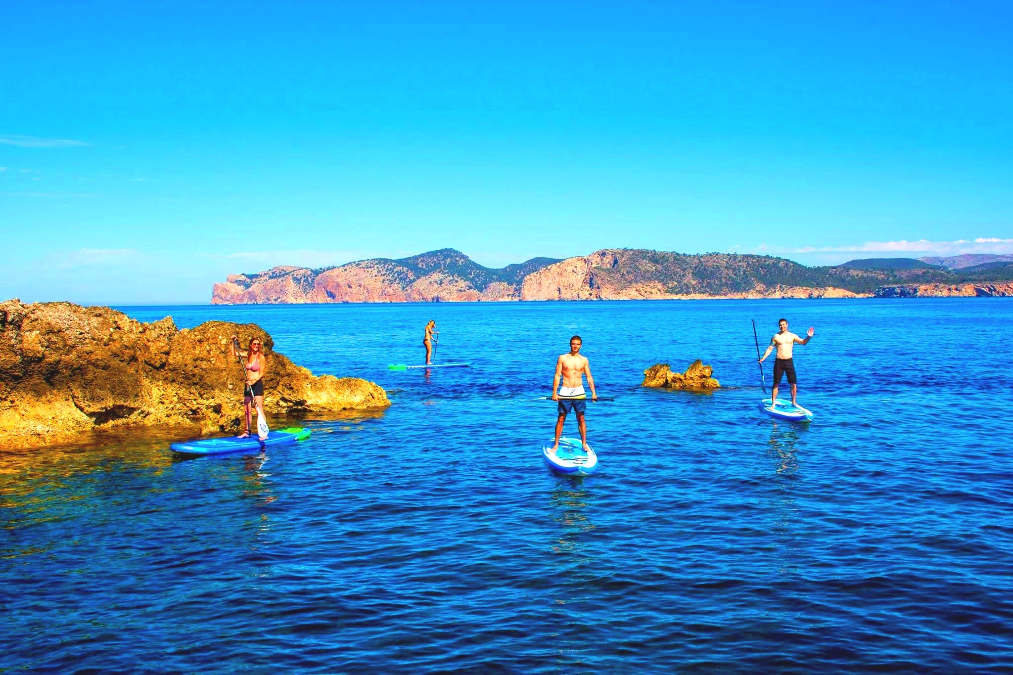 Some guys are taking part in a SUP tour in Mallorca.