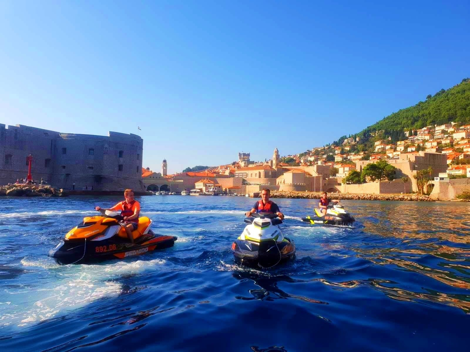 A group of participants of the Jet Ski excursion to Dubrovnik is leaving the city.