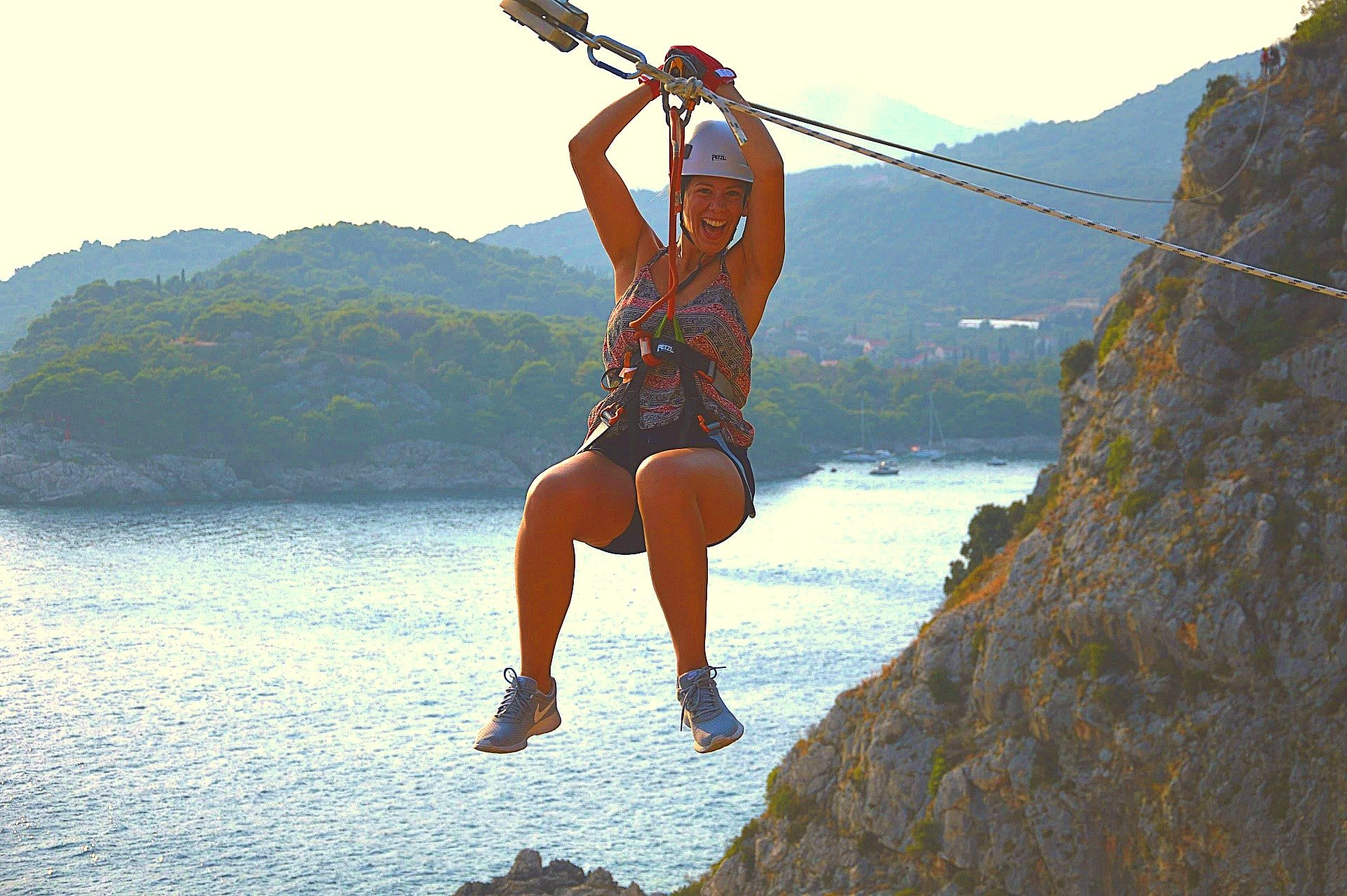 A girl admires the view as she takes the Zipline route.
