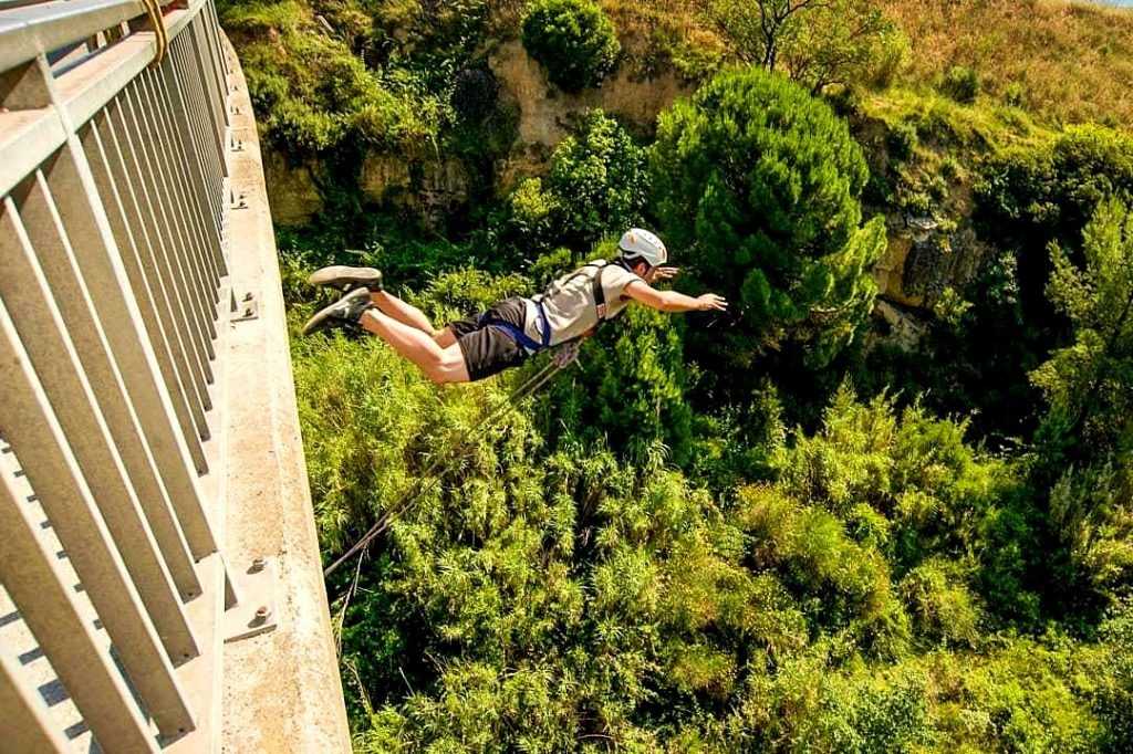 A guy feels the thrill of bungee jumping near Barcelona, a beautiful outdoor activity near Barcelona.
