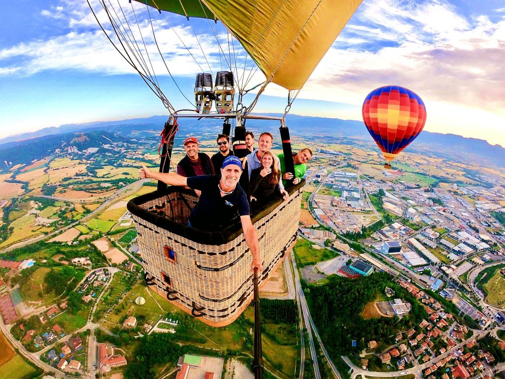 A group of people take a balloon ride near Barcelona, a beautiful outdoor activity around Barcelona.
