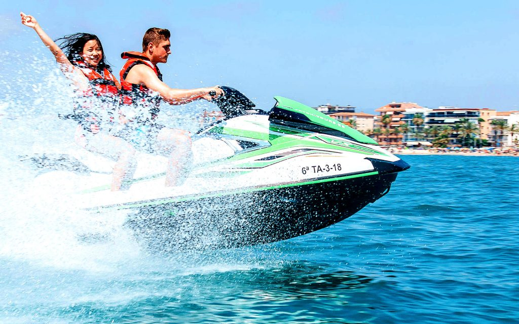 Two young people enjoy Jet Skiing in Barcelona, a beautiful outdoor activity in Barcelona.
