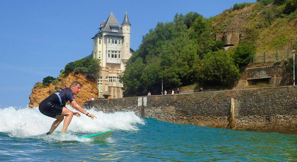A man is practicing during a surfing lesson in Biarritz.