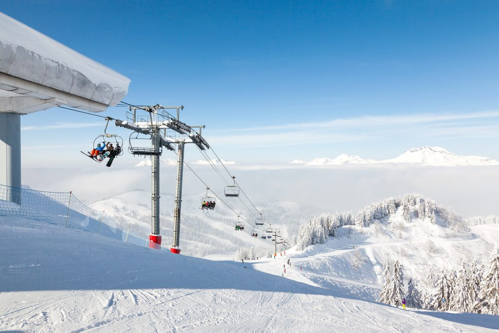 The ski lift is full of people who are ready to learn to ski in Morzine.