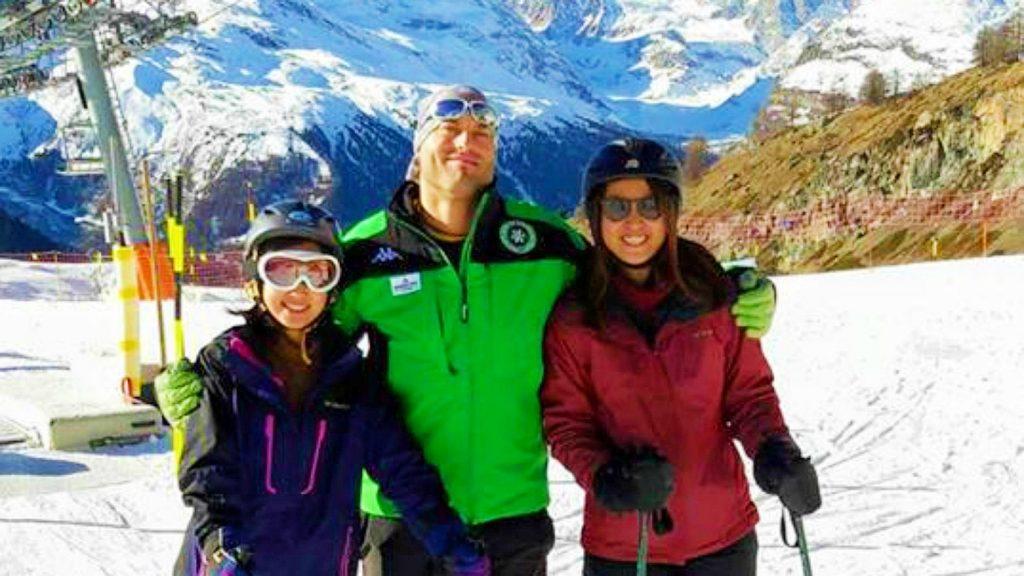 Two girls learn to ski in Zermatt with a ski instructor.