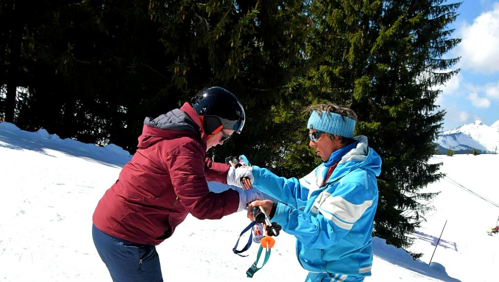A woman takes skiing lessons, among the things to do in Morzine, skiing is definitely the most popular.